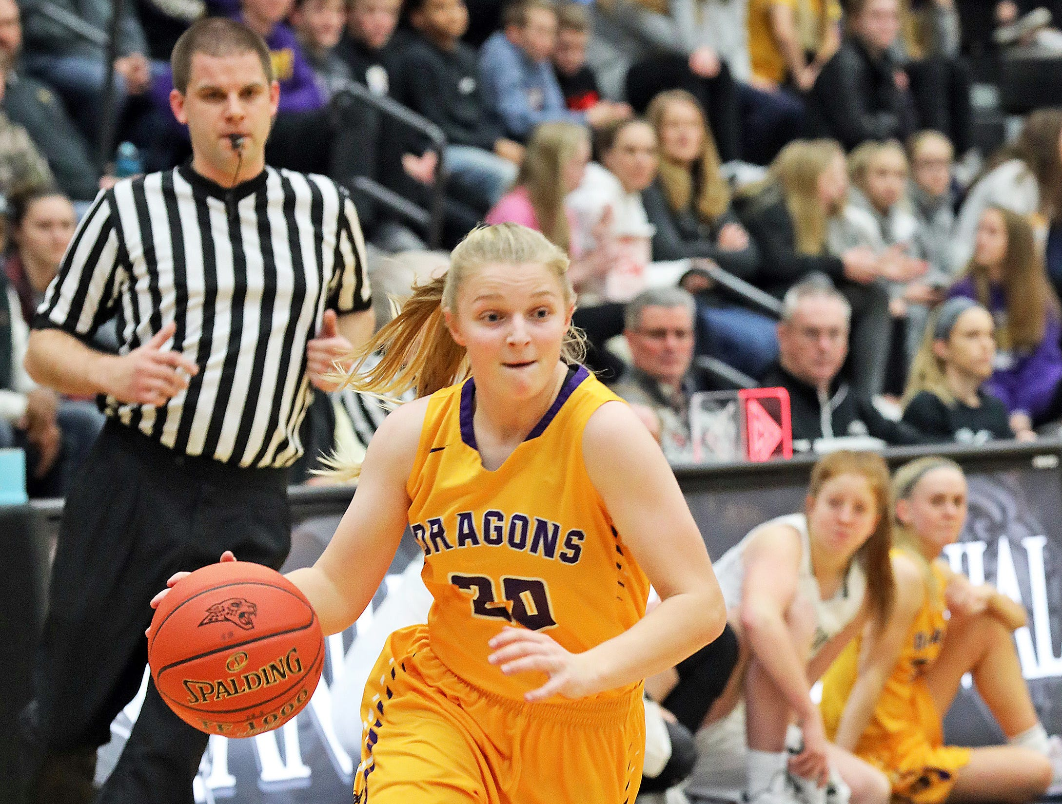 Johnston freshman Anna Gossling drives towards the basket as the Johnston Dragons compete against the Ankeny Centennial Jaguars in high school girls basketball on Friday, Jan. 4, 2019 at Ankeny Centennial High School.
