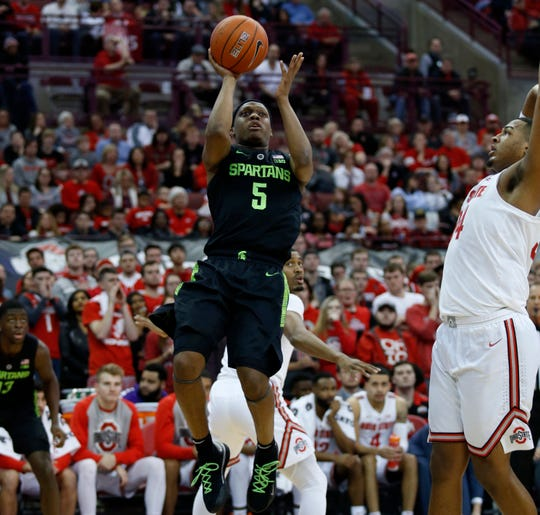 Michigan State guard Cassius Winston shoots against Ohio State forward Kaleb Wesson during the first half in Columbus, Ohio, Saturday, Jan. 5, 2019.