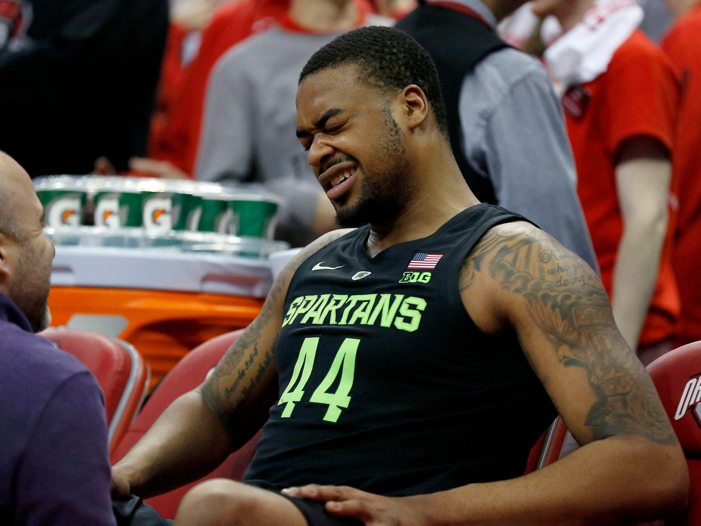 Michigan State forward Nick Ward sits on the bench in pain during the second half against Ohio State, Jan. 5, 2019 at Value City Arena in Columbus, Ohio.