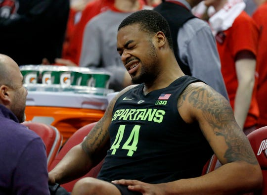 Nick Ward sits on the bench in pain during the second half against Ohio State on Saturday.