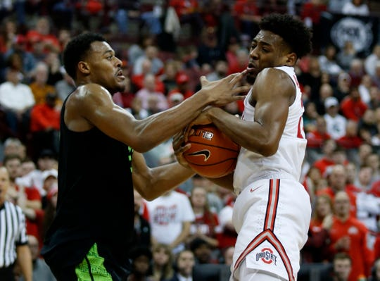 Michigan State forward Xavier Tillman works for the ball against Ohio State forward Andre Wesson during the second half in Columbus, Ohio, Saturday, Jan. 5, 2019.