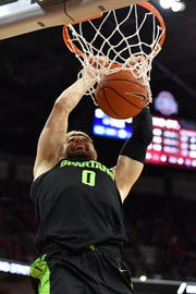 MSU's Kyle Ahrens finishes off a dunk in the second half at Ohio State.
