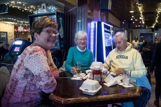 Suzette Waatti of Shelby Township smiles as she finishes up a meal with her mother Juanita Hurley of Rochester, center, and Harley Johnson at Mr. B's Food & Spirits in Rochester, Saturday, Jan. 5, 2019.