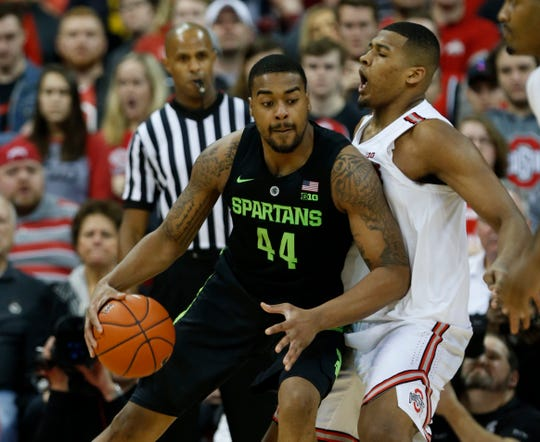 Nick Ward drives against Ohio State's Kaleb Wesson during the second half in Columbus, Ohio.