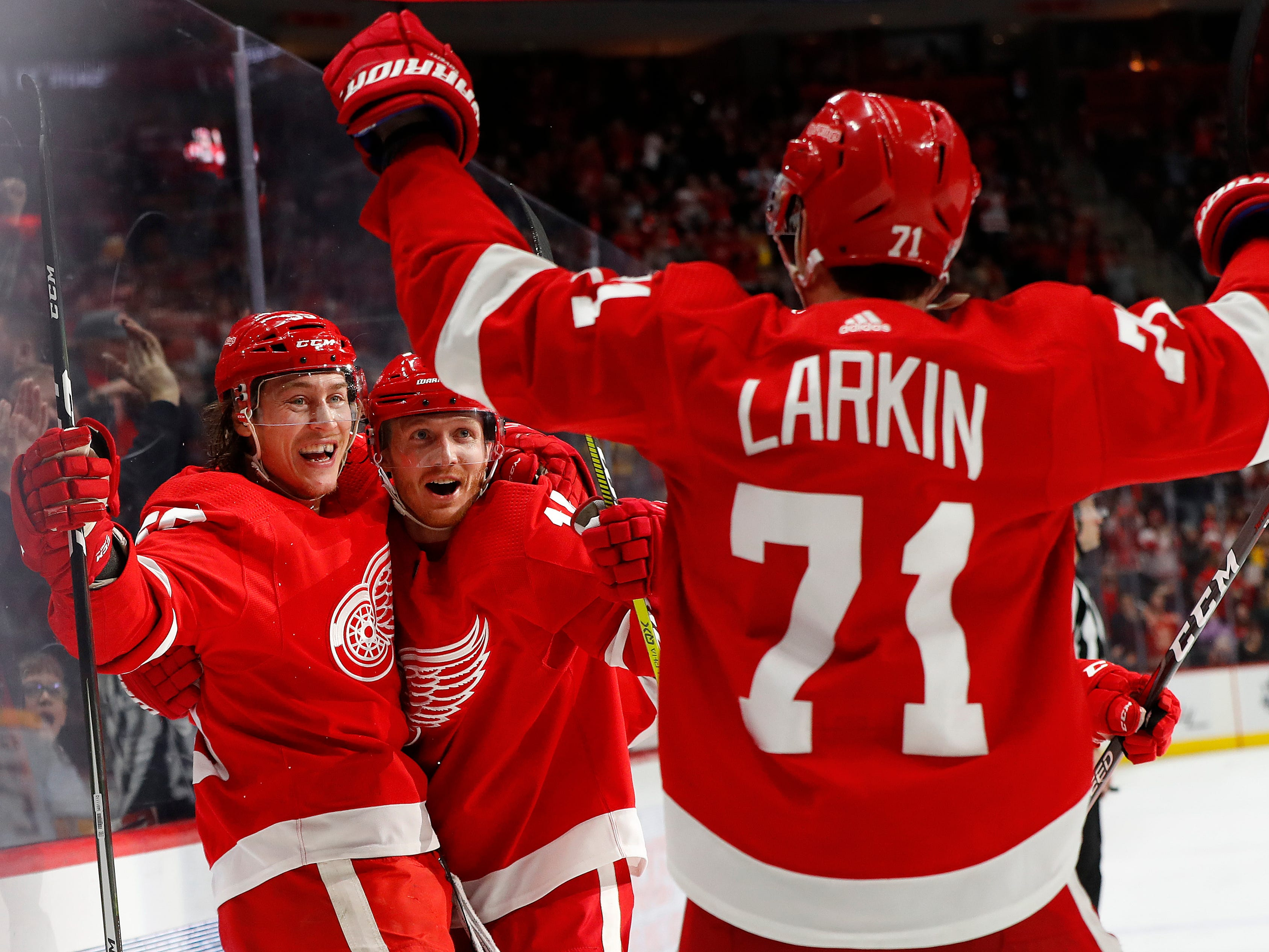 Detroit Red Wings' Tyler Bertuzzi, left, celebrates his goal against the Nashville Predators with Gustav Nyquist, center, and Dylan Larkin (71) in the third period.