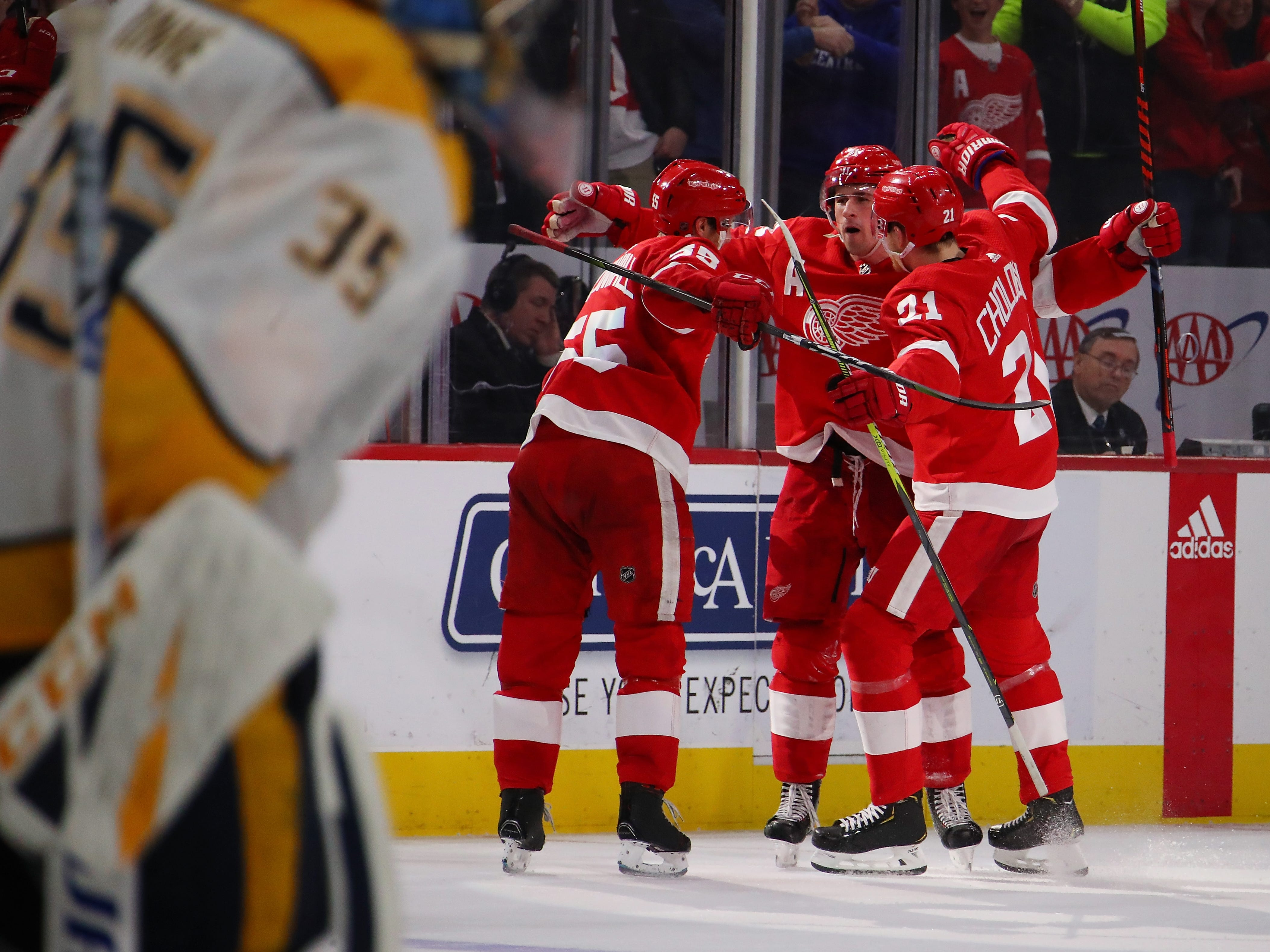 Red Wings' Dylan Larkin (71) of the Detroit Red Wings reacts to his game winning overtime goal with teammates.