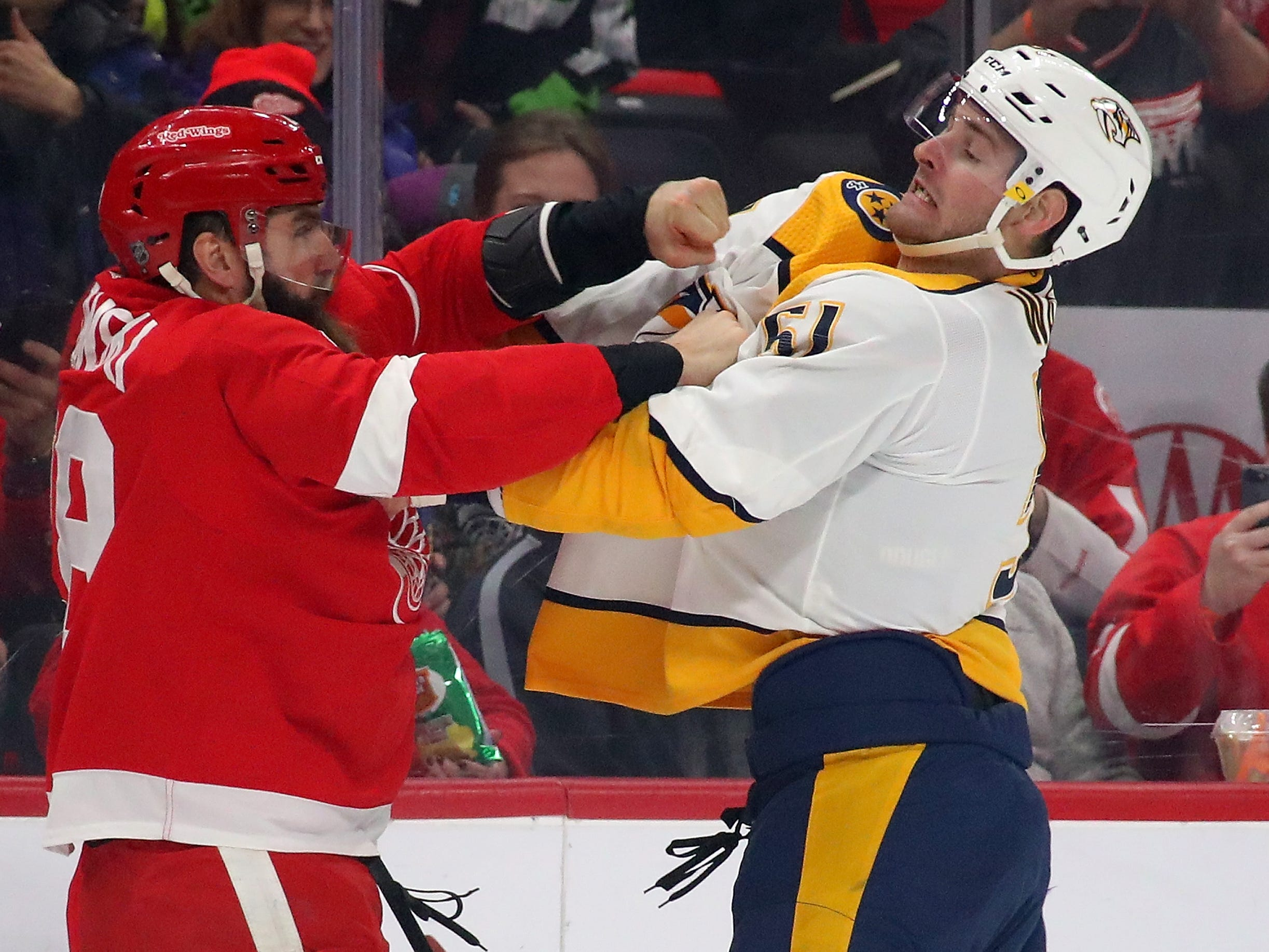 Predators' Austin Watson (51) fights Red Wings' Luke Witkowski (28) in the first period at Little Caesars Arena on Jan. 4, 2019 in Detroit, Michigan.