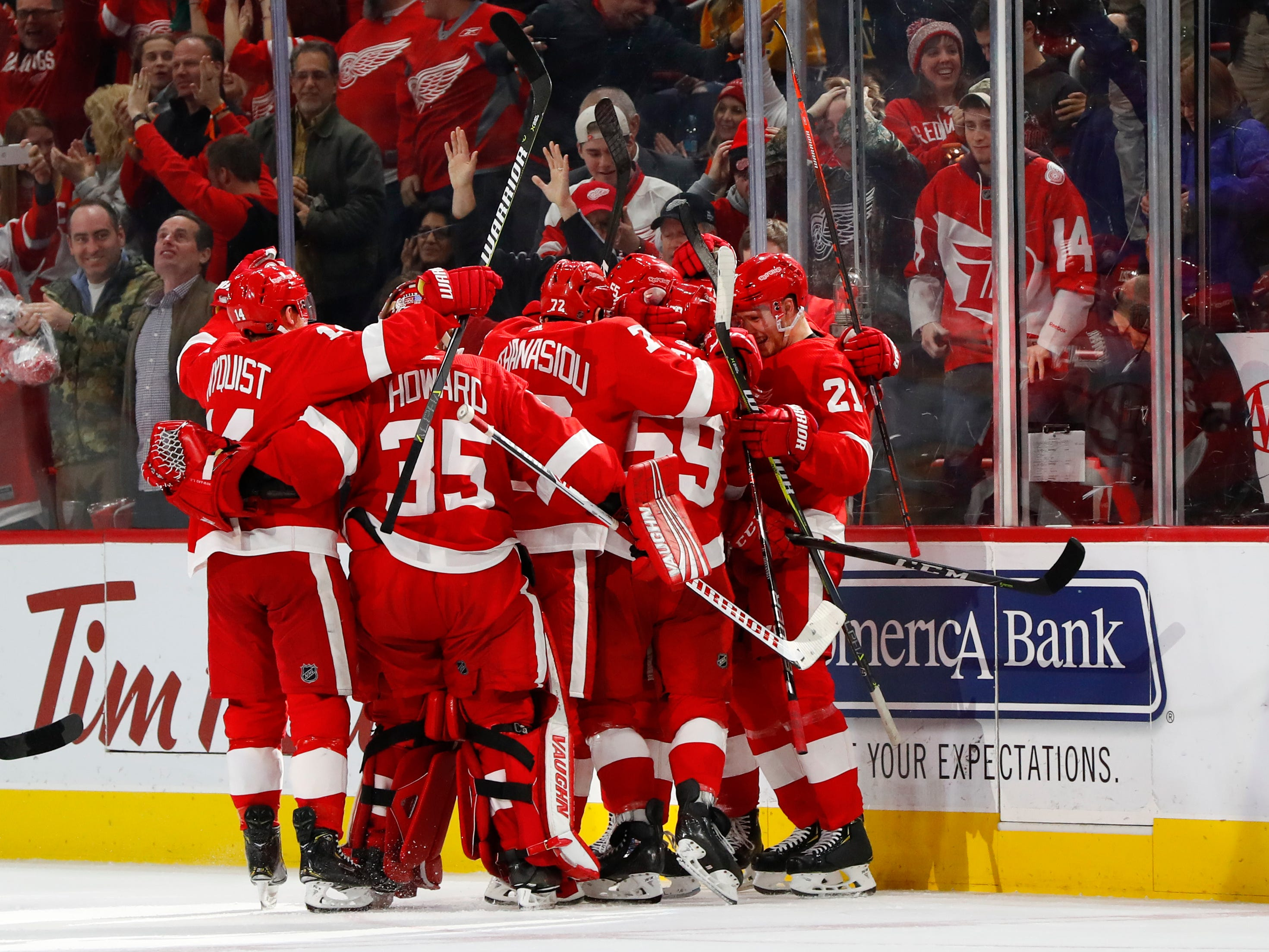 Detroit Red Wings center Dylan Larkin celebrates his goal with teammates in overtime.