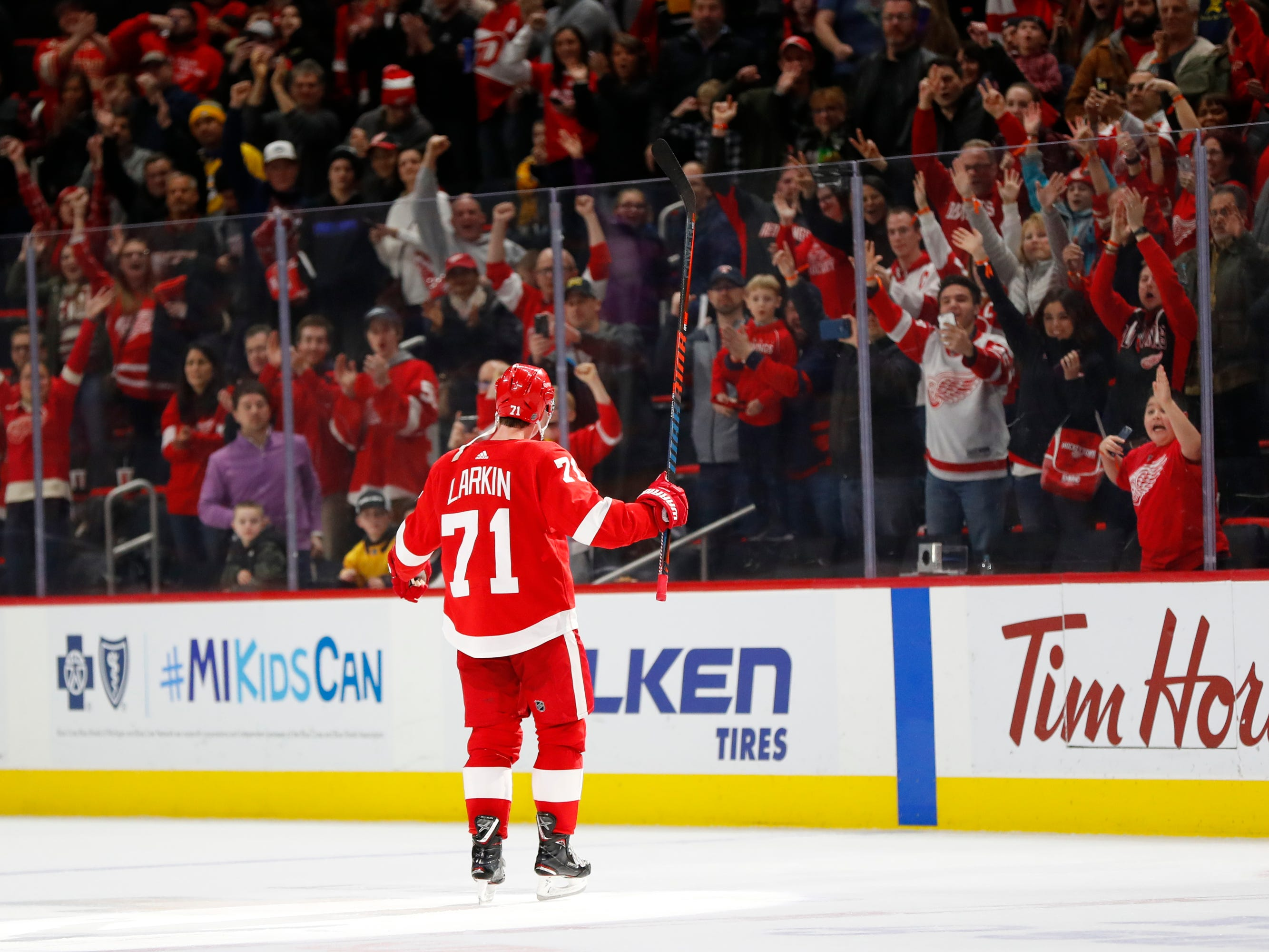 Detroit Red Wings center Dylan Larkin celebrates his goal during overtime.