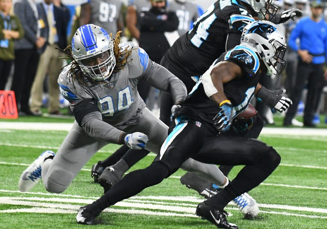 Ziggy Ansah, left, only played seven games and finished with four sacks in 2018.