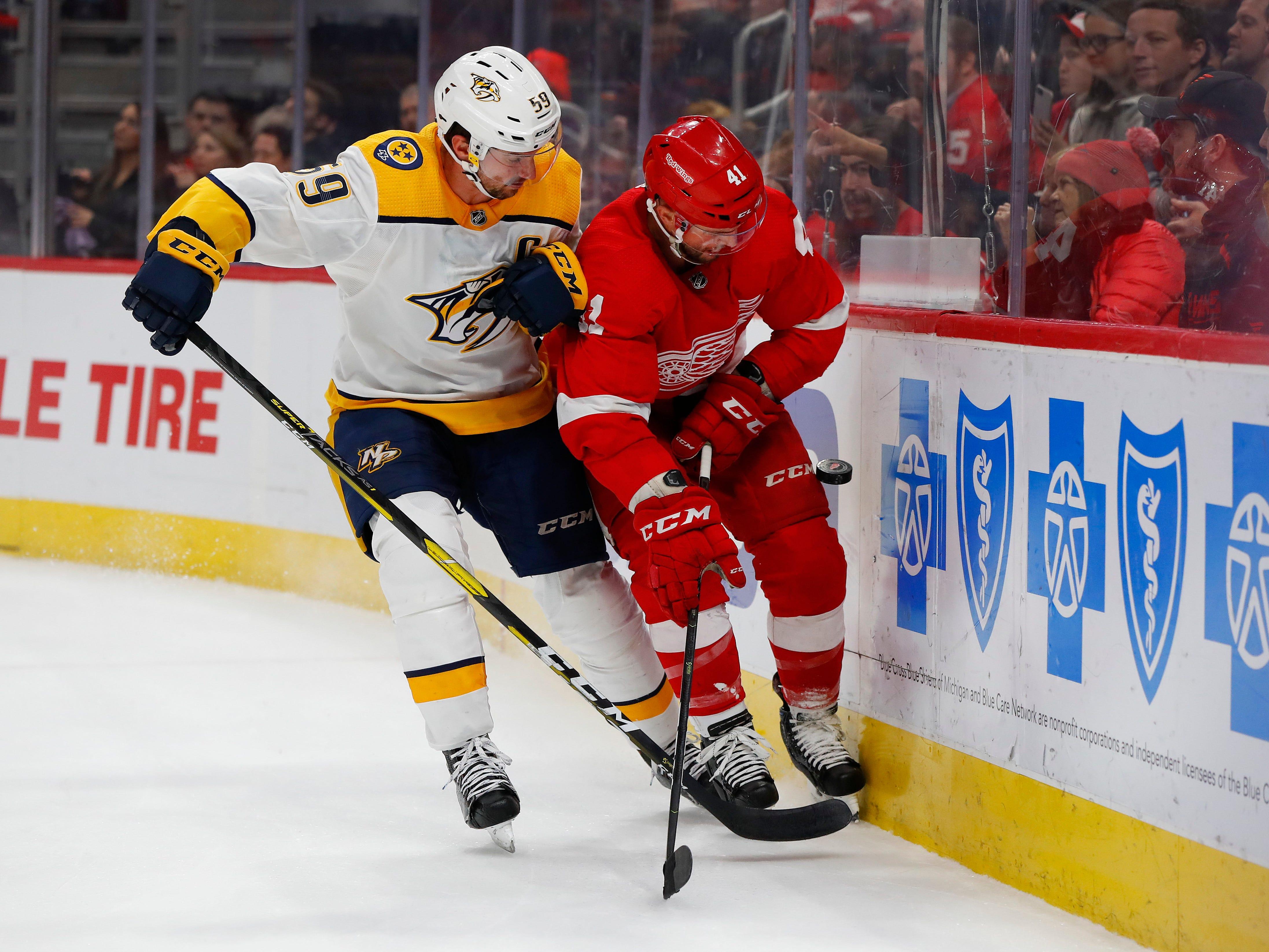 Nashville Predators defenseman Roman Josi (59) and Detroit Red Wings center Luke Glendening (41) battle for the puck in the third period.