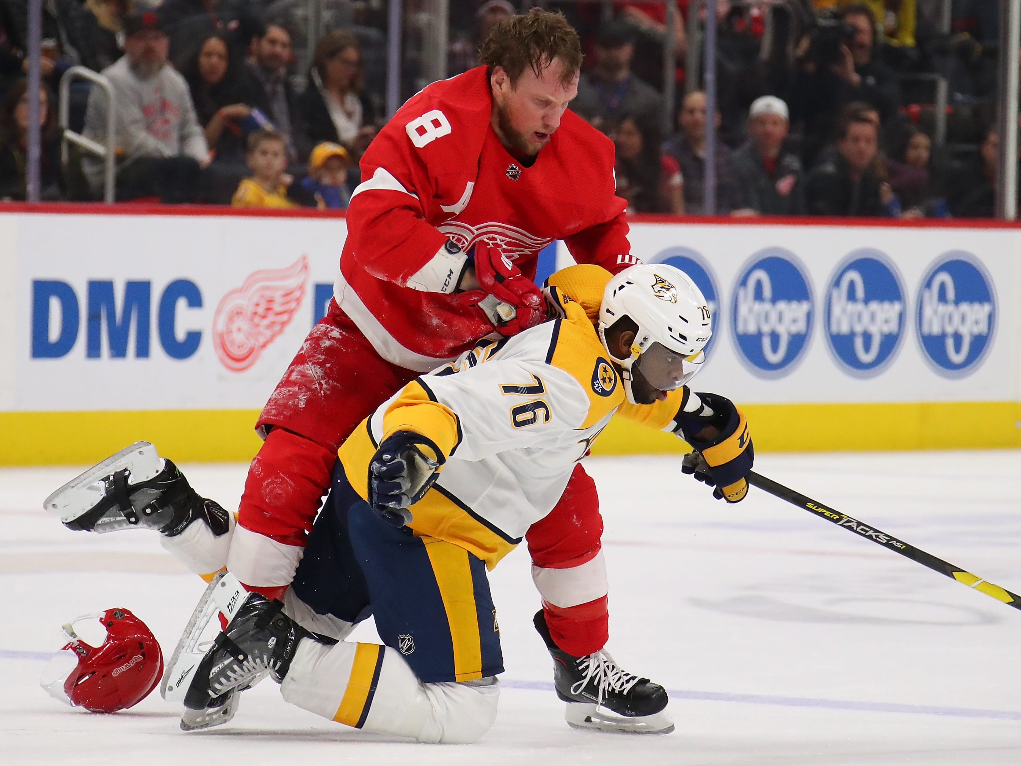 Red Wings'  Justin Abdelkader (8) battles with Predartors' P.K. Subban (76)\ during the first period.