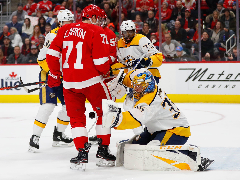 Nashville Predators goaltender Pekka Rinne (35) stops a shot as Detroit Red Wings center Dylan Larkin (71) screens his view in the first period.