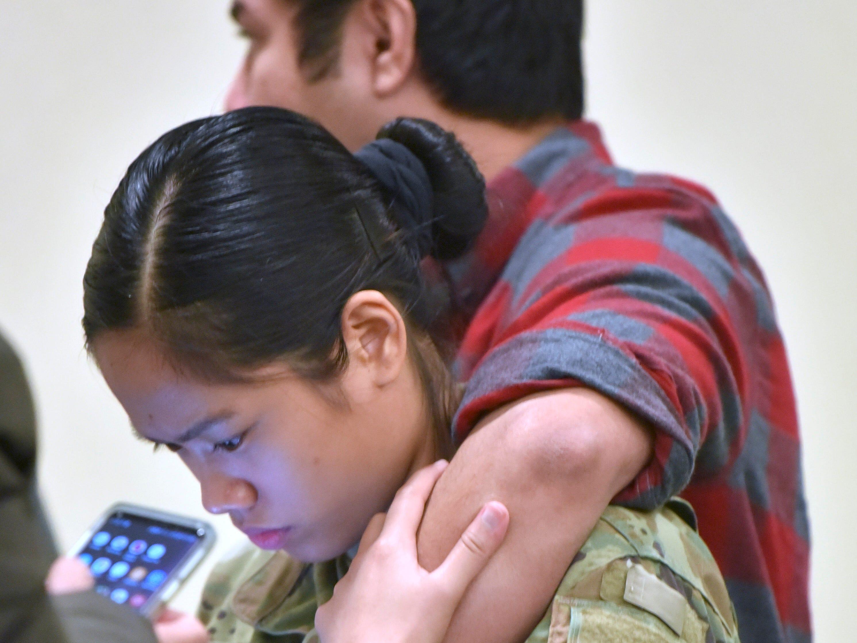 Radhwan Tannira puts his arm around his girlfriend E4 Specialist Hesse Sambaan, who is also an EMU nursing student.