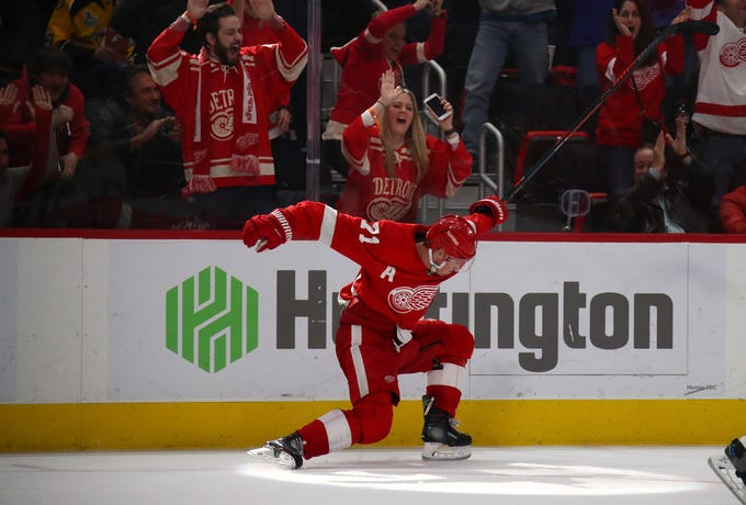 Red Wings' Dylan Larkin reacts to his game winning overtime goal to beat the  Nashville Predators 4-3 at Little Caesars Arena on Jan. 4, 2019 in Detroit, Michigan.