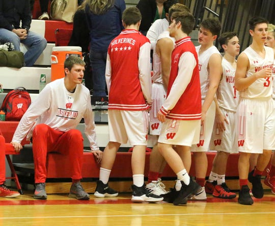 Waverly's Scott Woodring, left, was left to cheer on his teammates from the bench against Spencer-Van Etten on Jan. 4, 2019 because of a knee injury.