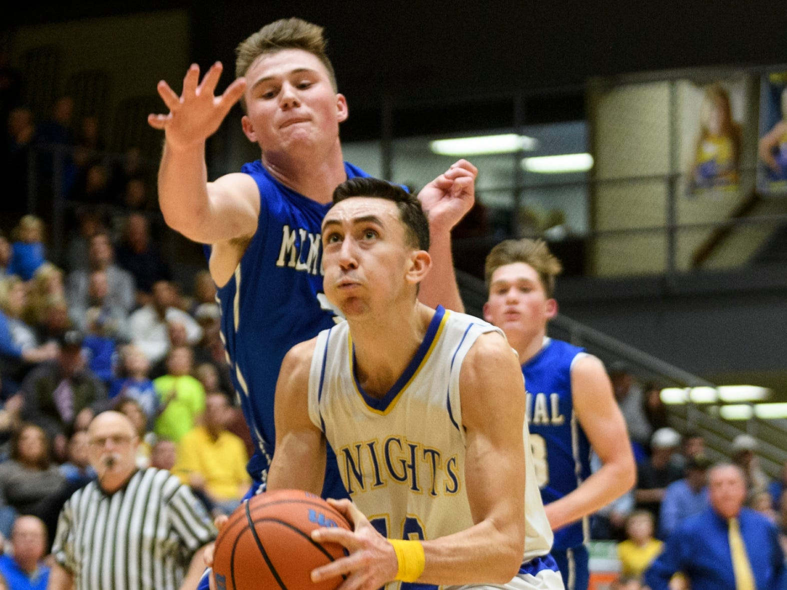 Memorial's Branson Combs (3) attempts to stop Castle's Alex Hemenway (12) from advancing to the net during the second quarter at Castle High School in Newburgh, Ind., Friday, Jan. 4, 2019. The Knights defeated the Tigers, 72-43.