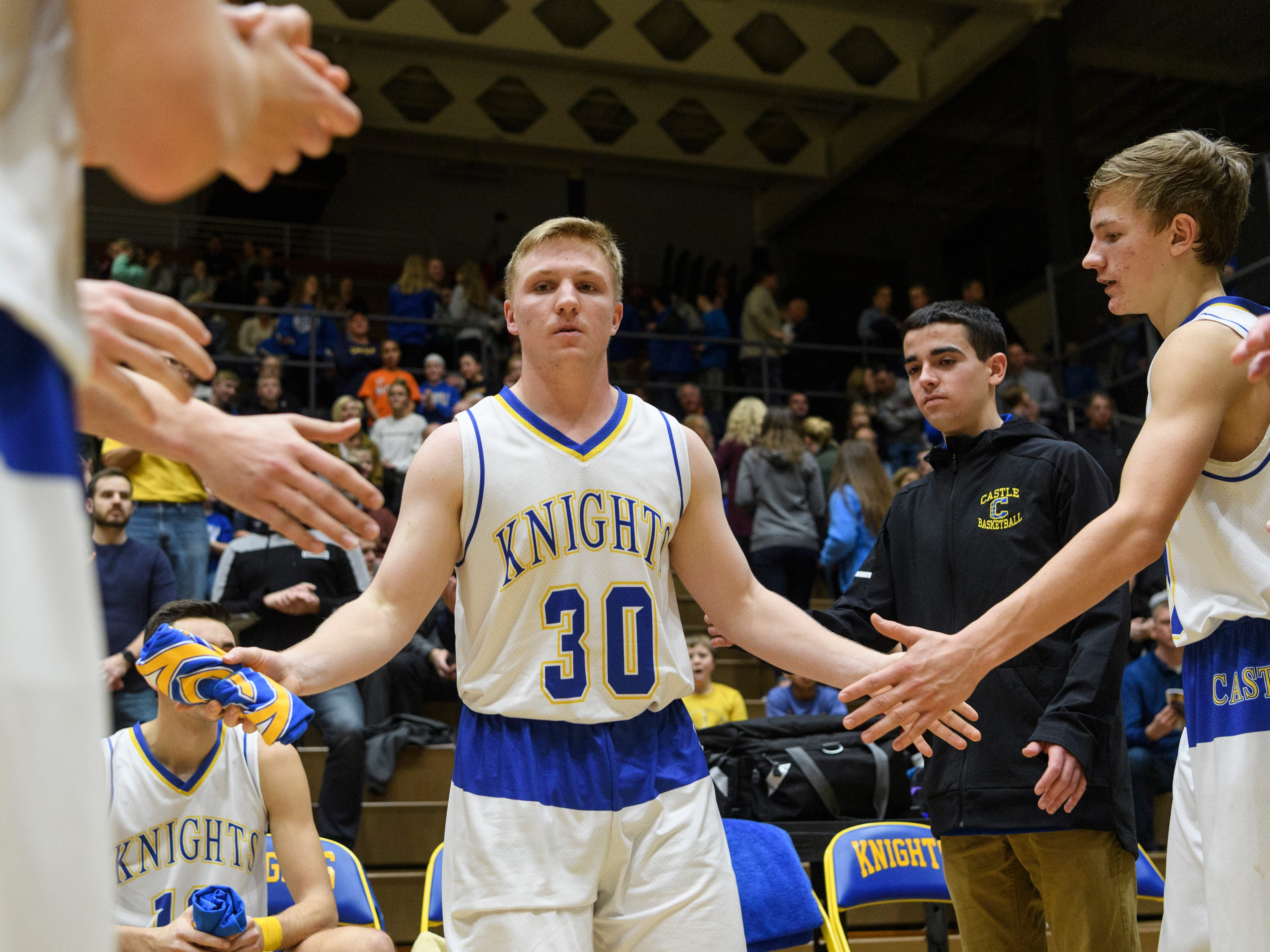 Castle's Brycen Moore (30) is announced as a starter before the game against the Memorial Tigers at Castle High School in Newburgh, Ind., Friday, Jan. 4, 2019. The Knights defeated the Tigers, 72-43.