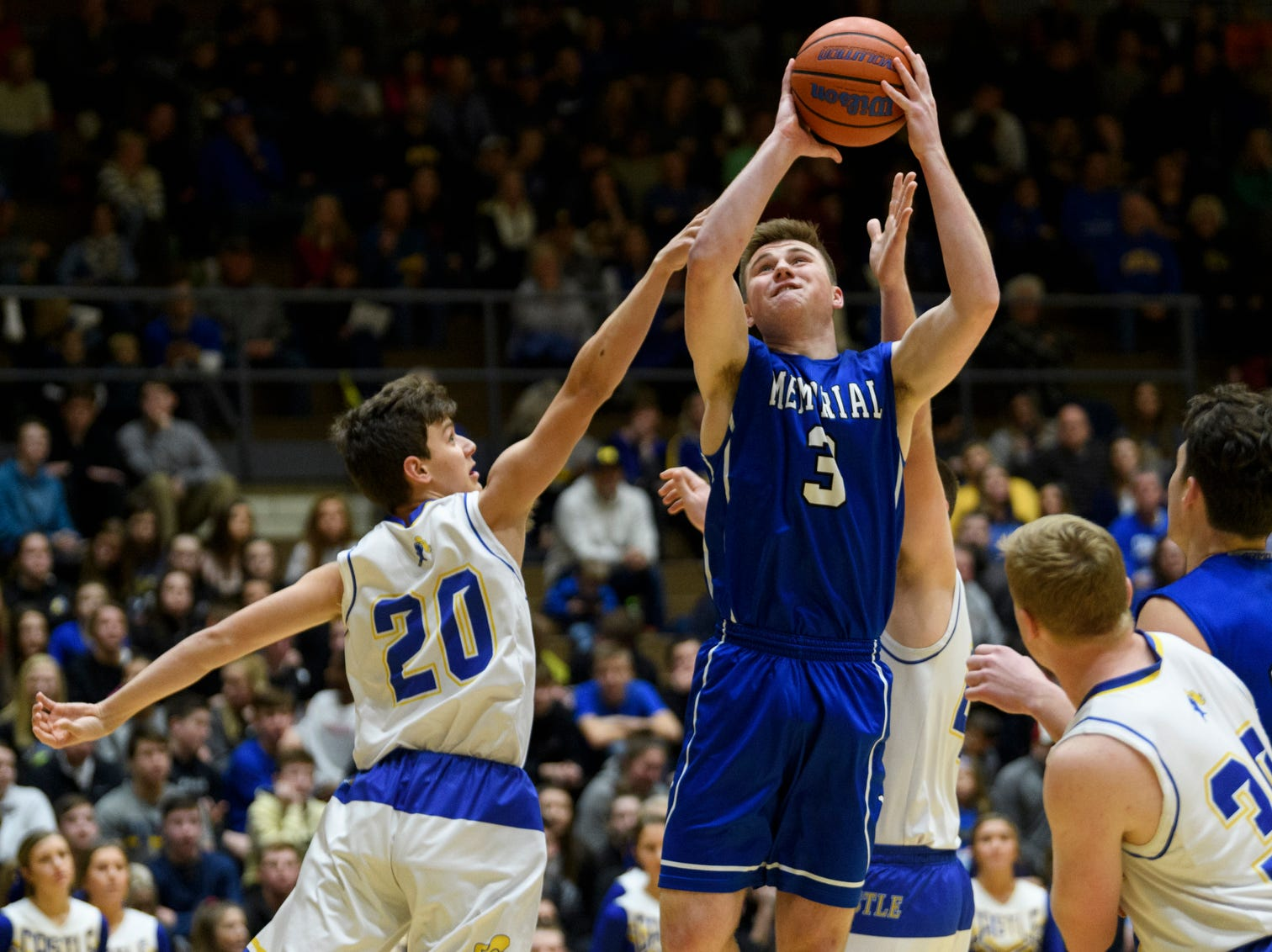 Memorial's Branson Combs (3) makes the first points of the game in first quarter before Castle's Bob Nunge (20) and Castle's Brodey Heaton (44) could stop him at Castle High School in Newburgh, Ind., Friday, Jan. 4, 2019.