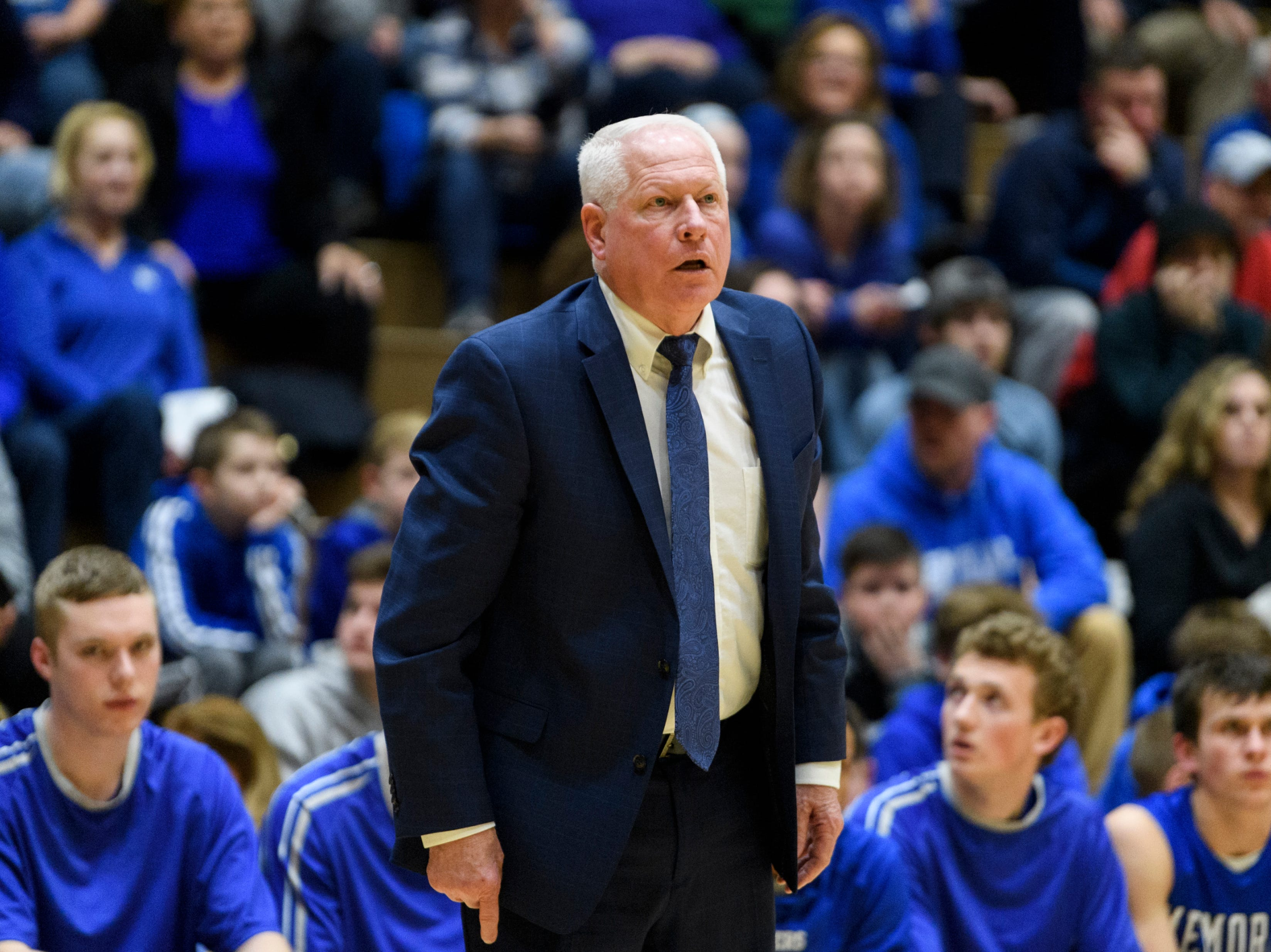 Memorial Head Coach Rick Wilgus watches his team take on the Castle Knights at Castle High School in Newburgh, Ind., Friday, Jan. 4, 2019. The Knights defeated the Tigers, 72-43.