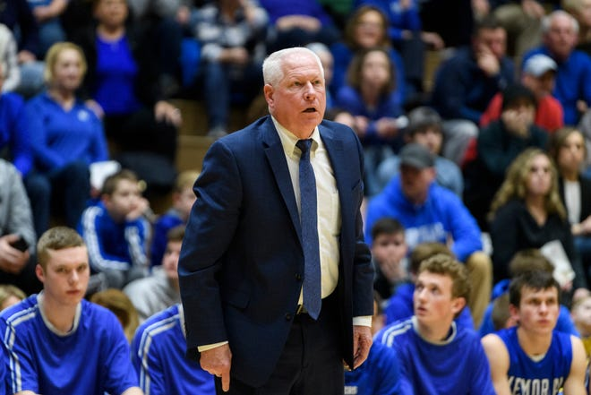 Memorial coach Rick Wilgus watches his team in a game against Castle. The long-time coach announced his retirement after 38 years as a head coach in Indiana.