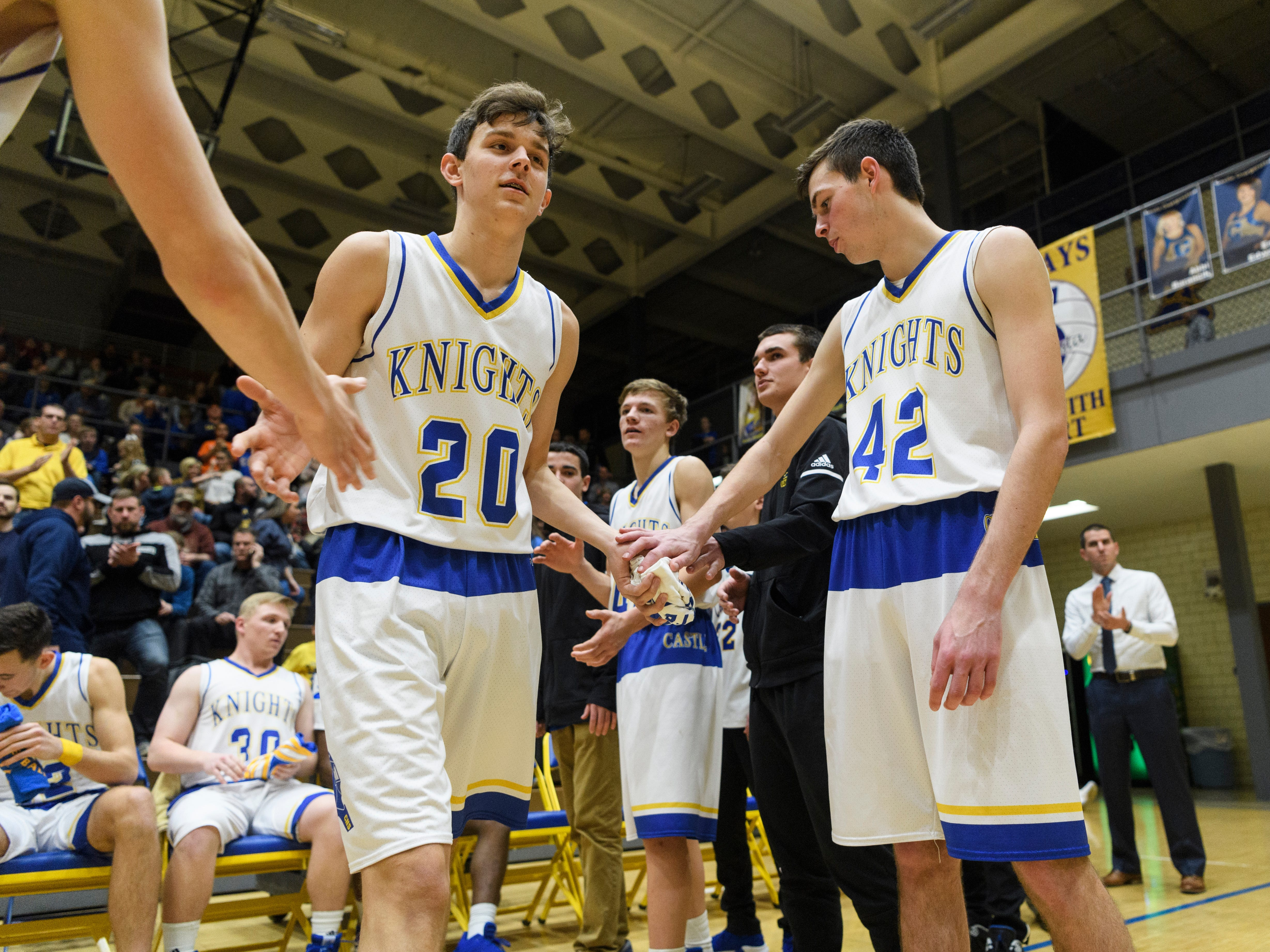Castle's Bob Nunge (20) is announced as a starter before the game against the Memorial Tigers at Castle High School in Newburgh, Ind., Friday, Jan. 4, 2019. The Knights defeated the Tigers, 72-43.