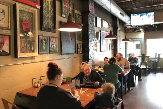 If you manage to look away from your yummy food, you'll find the walls of the Franklin Street Pizza Factory lined with ever-changing local art.