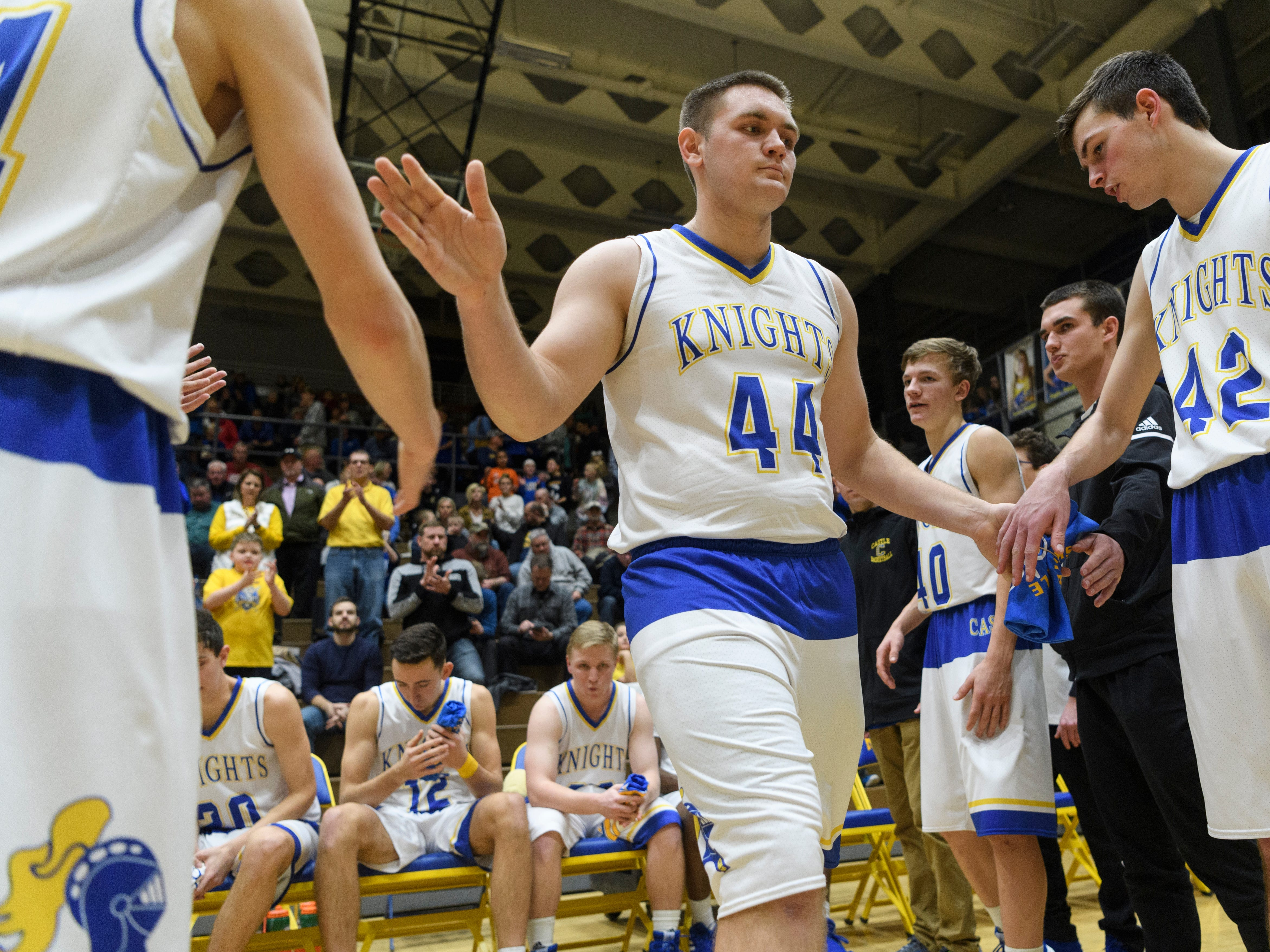 Castle's Brodey Heaton (44) is announced as a starter before the game against the Memorial Tigers at Castle High School in Newburgh, Ind., Friday, Jan. 4, 2019. The Knights defeated the Tigers, 72-43.