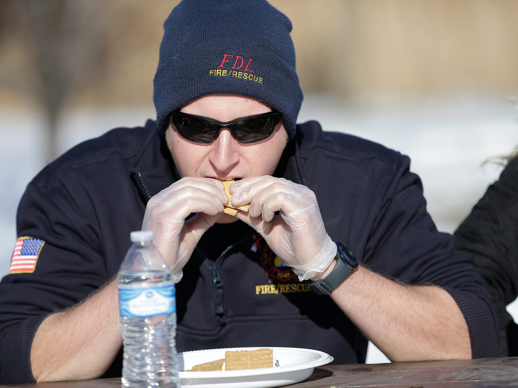 Connor Knaus of Fond du lac Fire/Rescue competes in the s'mores eating contest at Winterfest Saturday, January 5, 2019 at Hamilton park in Fond du Lac, Wisconsin. Doug Raflik/USA TODAY NETWORK-Wisconsin