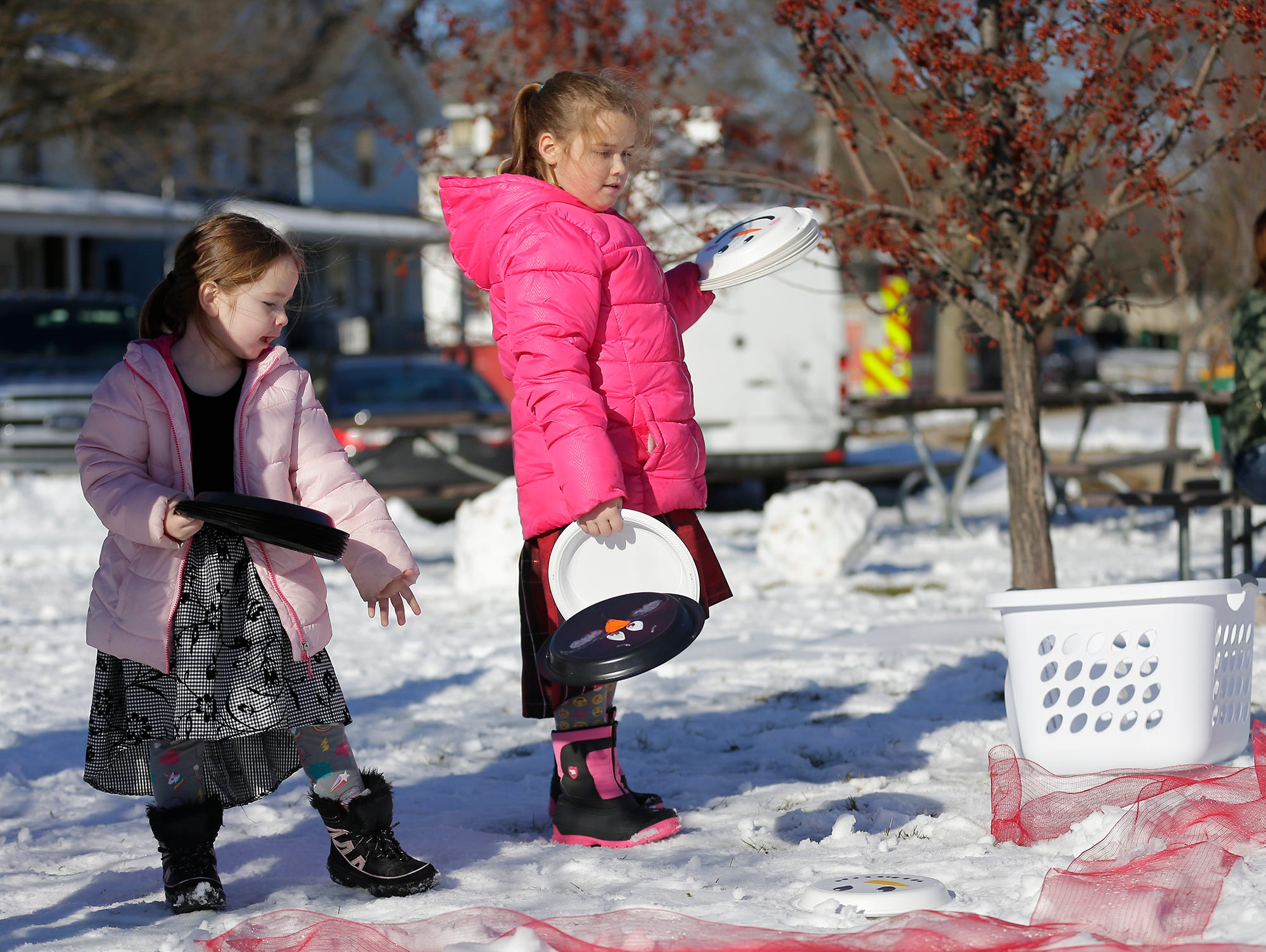 Phebe and Evelynn Karch of Fond du Lac play tic tac snow at Winterfest Saturday, January 5, 2019 at Hamilton park in Fond du Lac, Wisconsin. Doug Raflik/USA TODAY NETWORK-Wisconsin