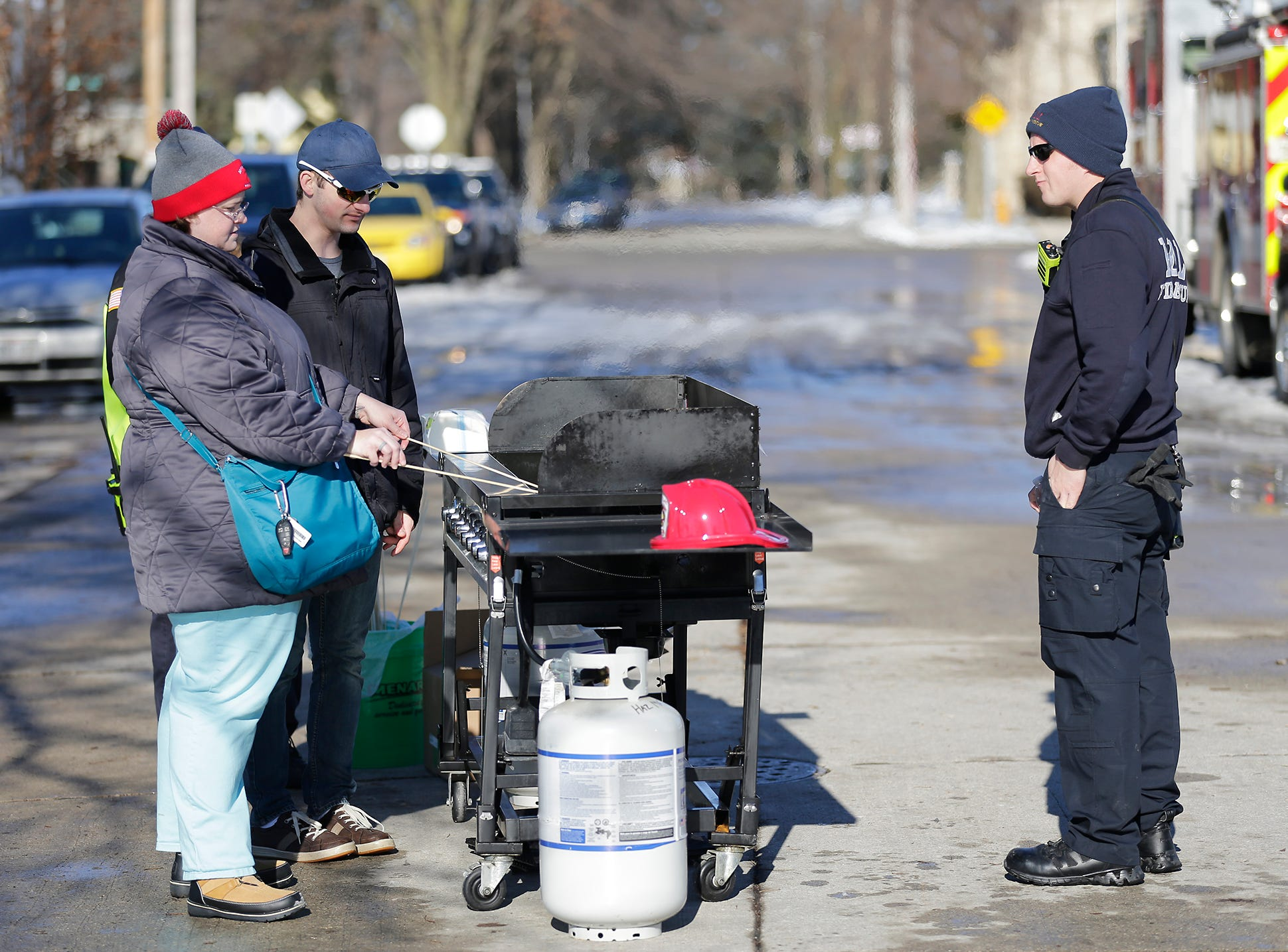Fond du Lac Fire/Rescue members man a grill where people could roast marshmallows at Winterfest Saturday, January 5, 2019 at Hamilton park in Fond du Lac, Wisconsin. Doug Raflik/USA TODAY NETWORK-Wisconsin