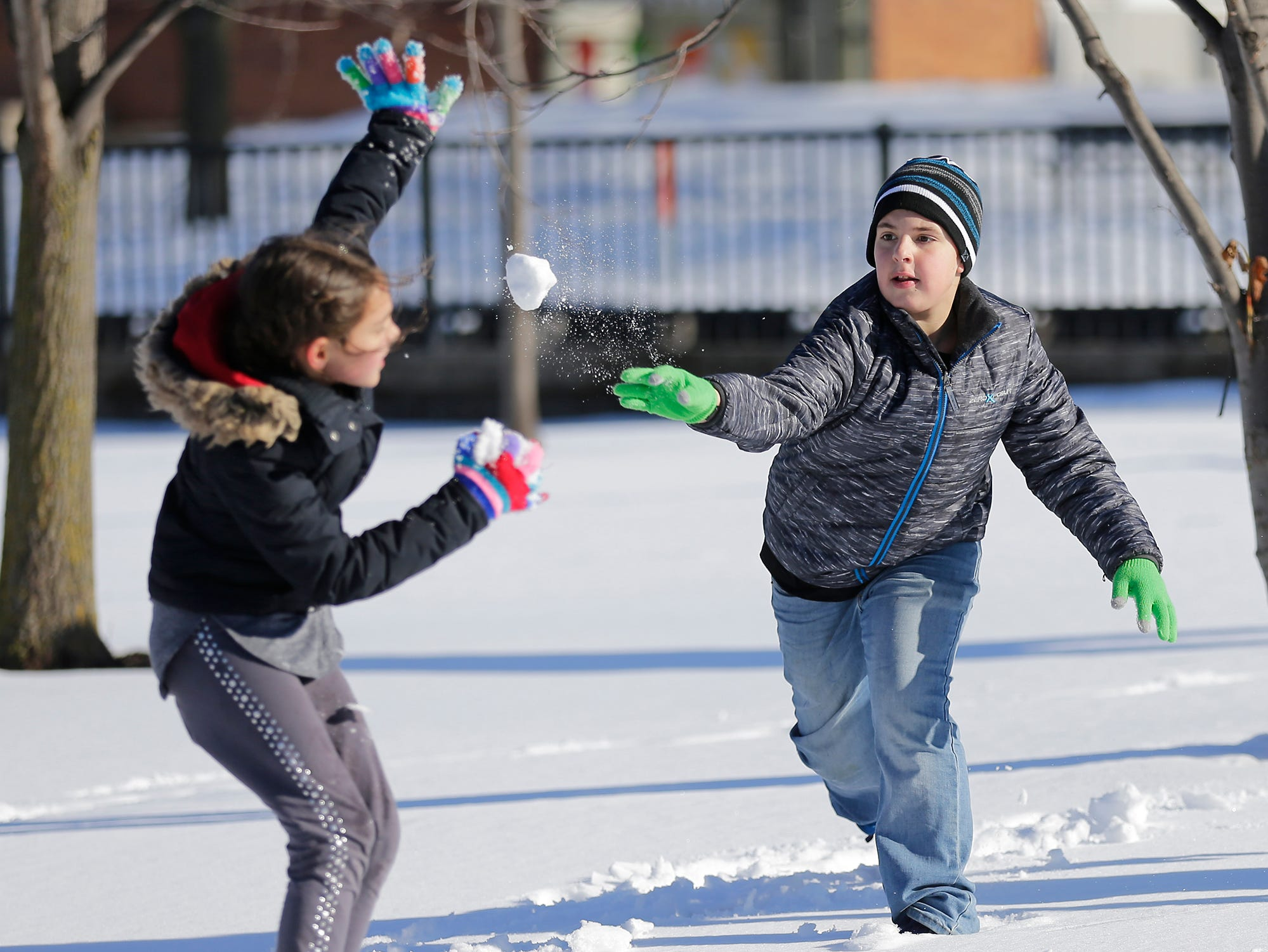 Dayton Shady throws a snowball at Naomi Connelly at Winterfest Saturday, January 5, 2019 at Hamilton park in Fond du Lac, Wisconsin. Doug Raflik/USA TODAY NETWORK-Wisconsin