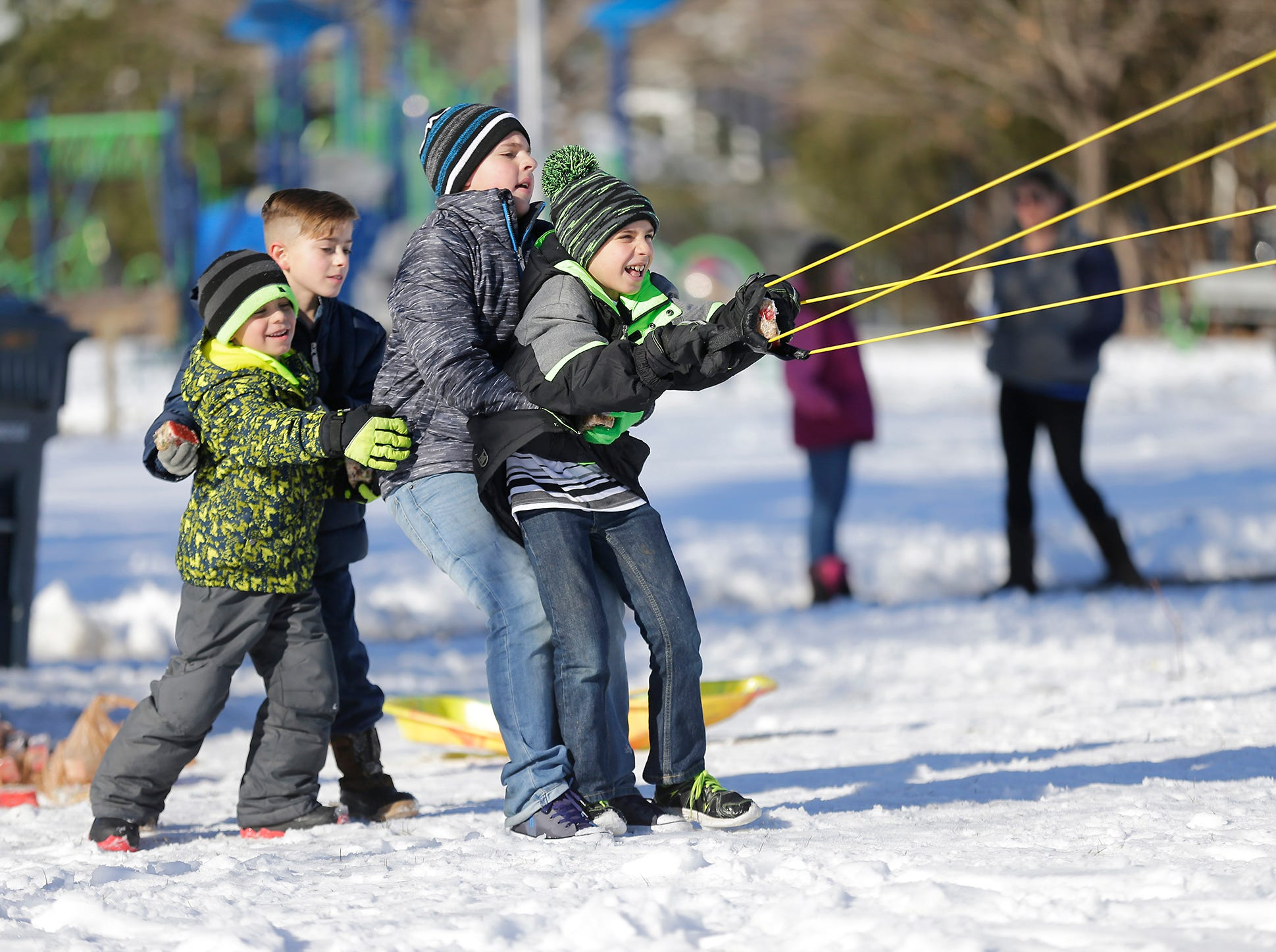 Chase Hafermann, Jacob Christenson and Dayton and Dylan Shady all help to pull back the fruit cake launcher at Winterfest Saturday, January 5, 2019 at Hamilton park in Fond du Lac, Wisconsin. Doug Raflik/USA TODAY NETWORK-Wisconsin