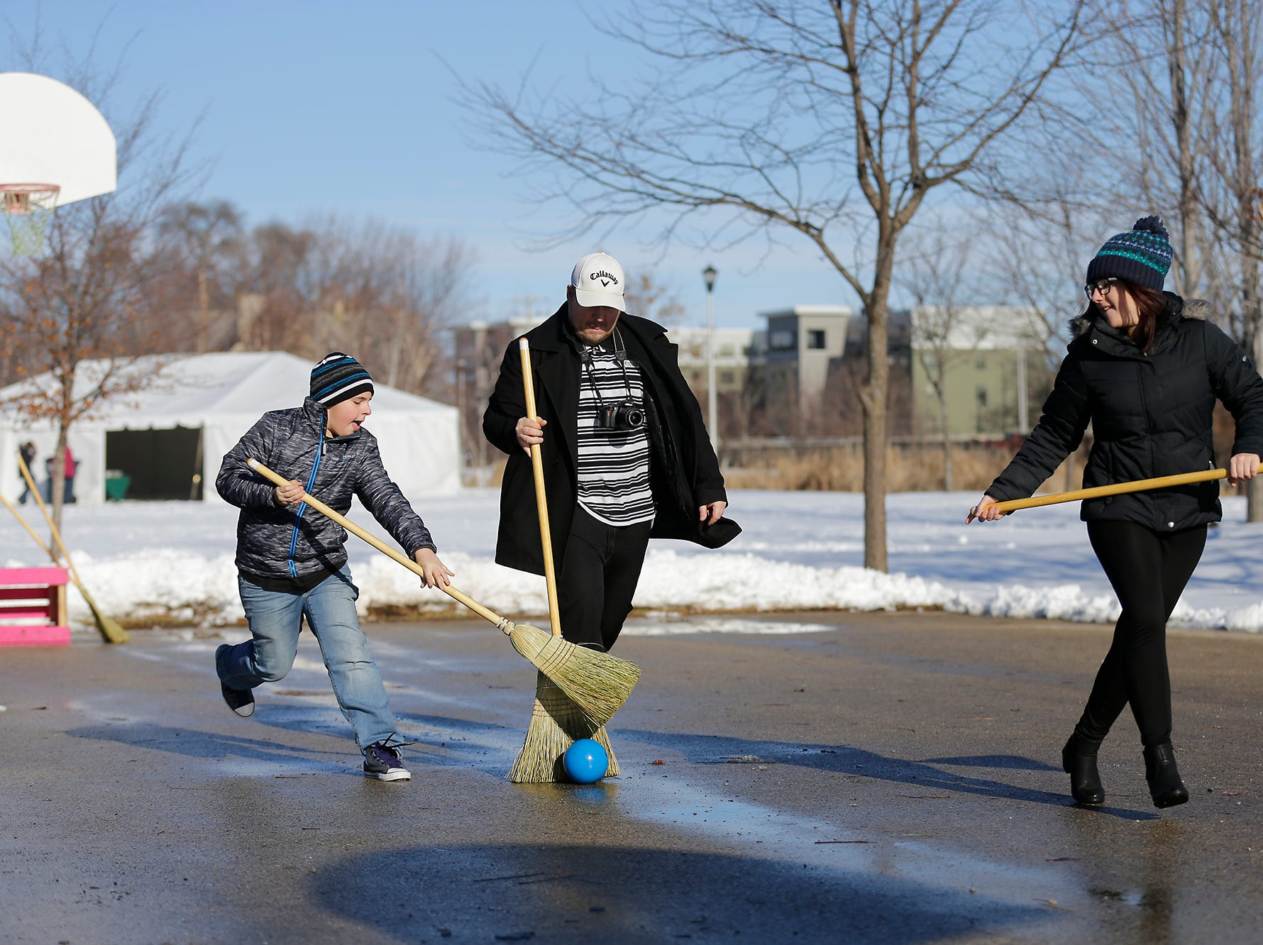 Dayton, Eric and Jaylyn Shady of Fond du Lac play broom ball at Winterfest Saturday, January 5, 2019 at Hamilton park in Fond du Lac, Wisconsin. Doug Raflik/USA TODAY NETWORK-Wisconsin