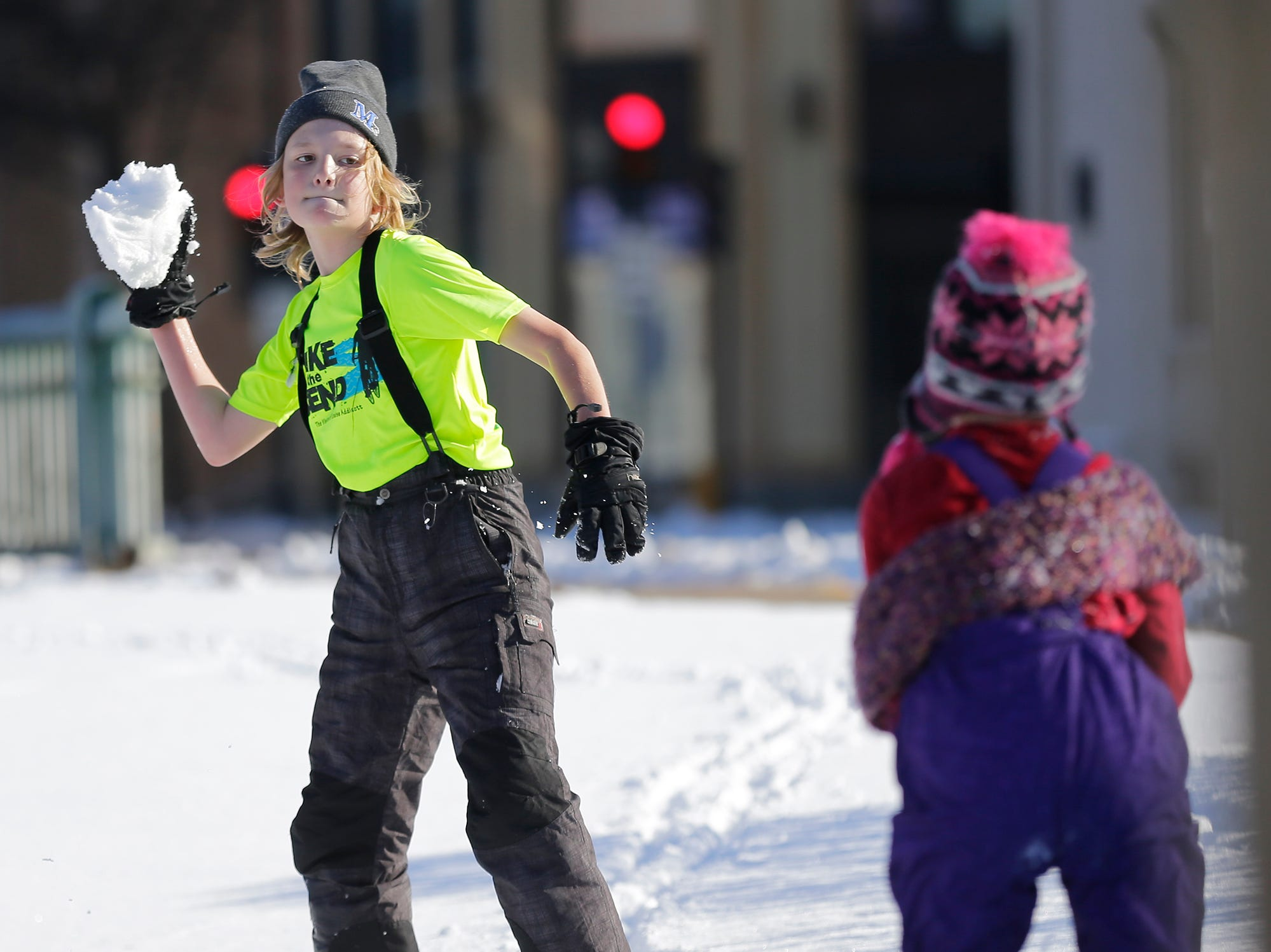 Miles Krikau winds up to throe a snowball at Winterfest Saturday, January 5, 2019 at Hamilton park in Fond du Lac, Wisconsin. Doug Raflik/USA TODAY NETWORK-Wisconsin