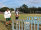 Island Coast football coach Jim Wiseman and Oasis Charter punter Weston Wilson check on a burrowing owl nest, empty at the time, at Cape Coral High School during practice for the Rotary South All-Star Classic, Dec. 3, 2018.