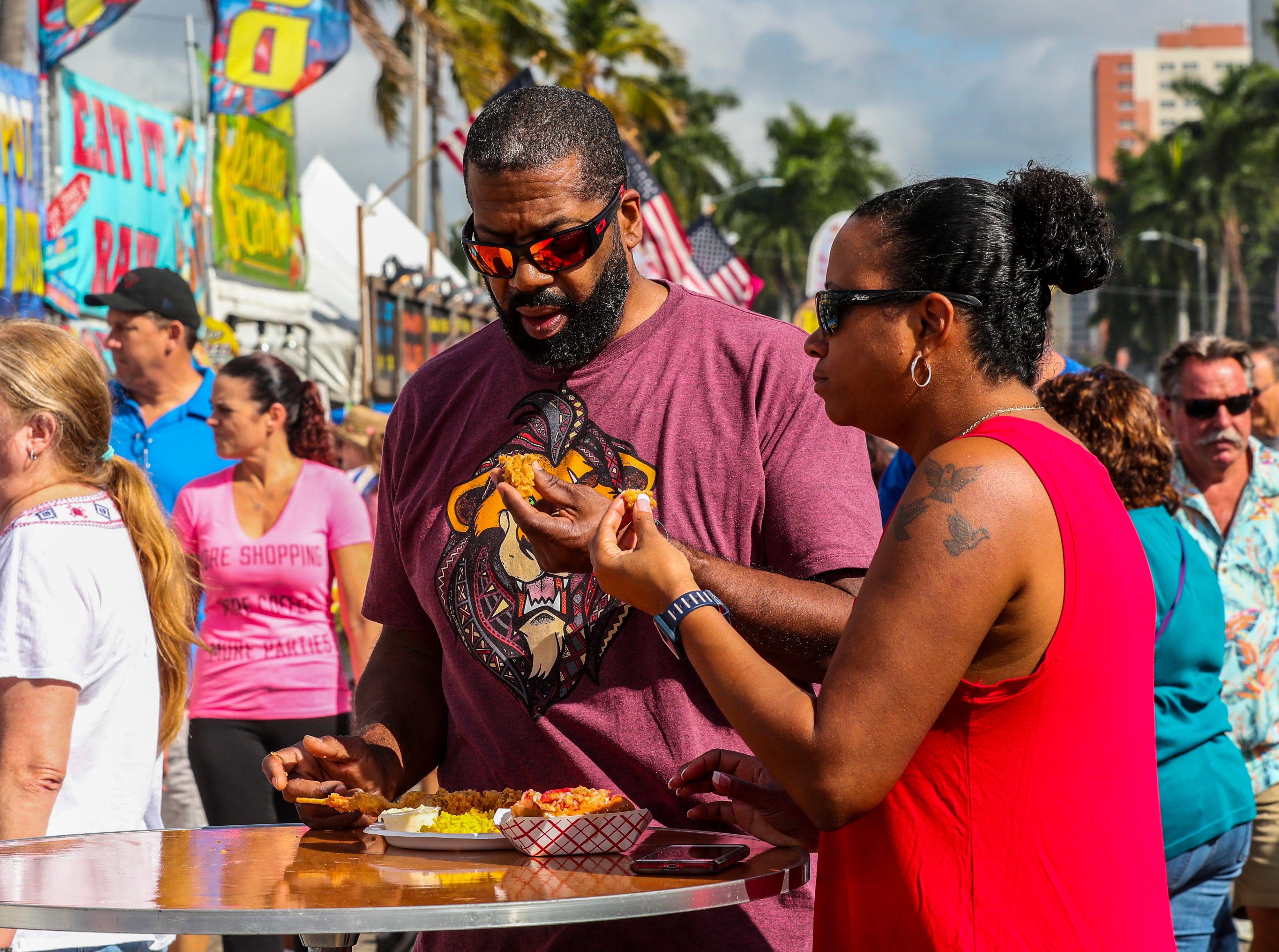 Tanis and Greg Wright, of Fort Myers, enjoy some shrimp from one of the vendors. Fort Myers Seafood and Music Festival is a new event for downtown Fort Myers that featured live bands, seafood dishes from vendors and local restaurants and a small marketplace with arts, crafts and more items.