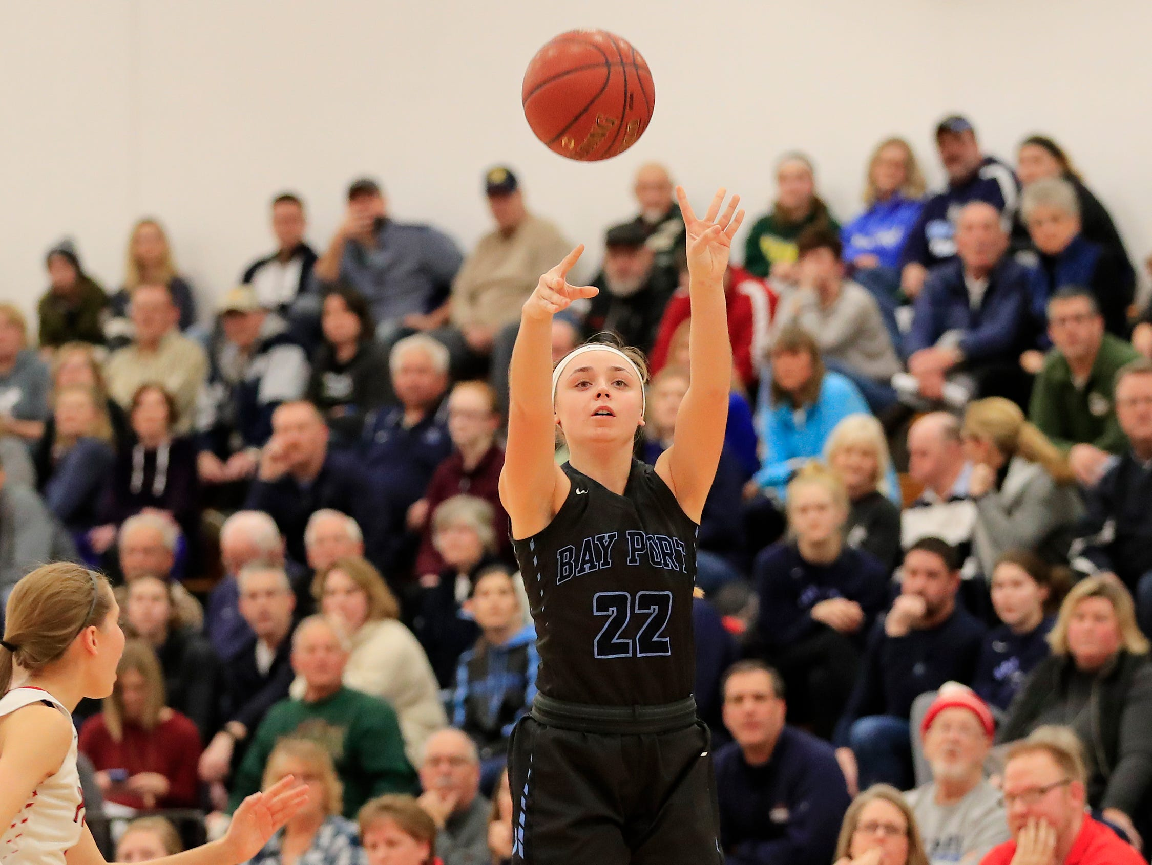 Bay Port's McKenzie Johnson (22) shoots a three against Pulaski in a girls basketball game at Pulaski high school on Friday, January 4, 2019 in Pulaski, Wis.