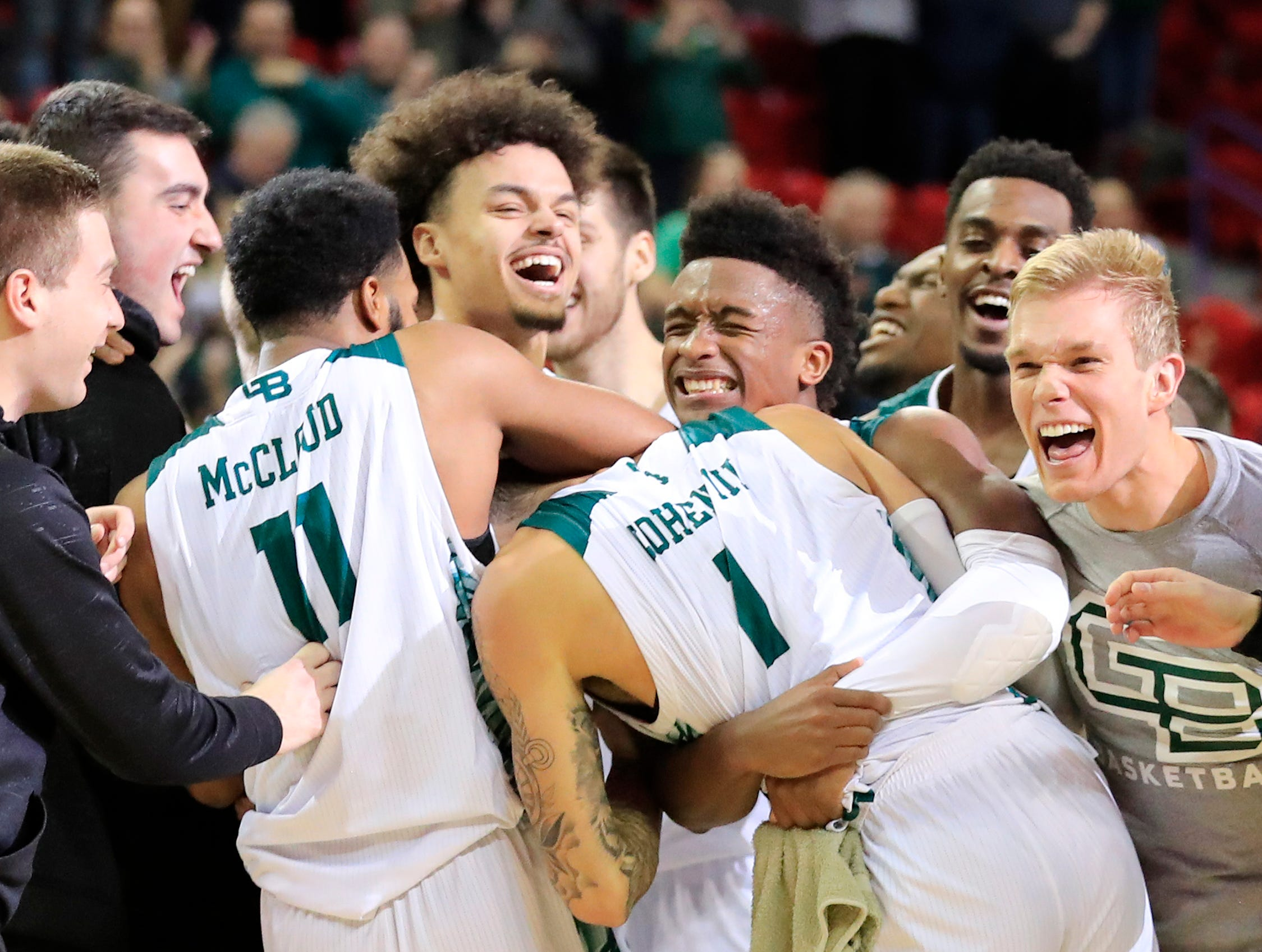 Green Bay Phoenix guard Sandy Cohen III (1) celebrates after hitting a buzzer beater to defeat the Cleveland State Vikings in a Horizon League basketball game at the Resch Center on Saturday, January 5, 2019 in Green Bay, Wis.
