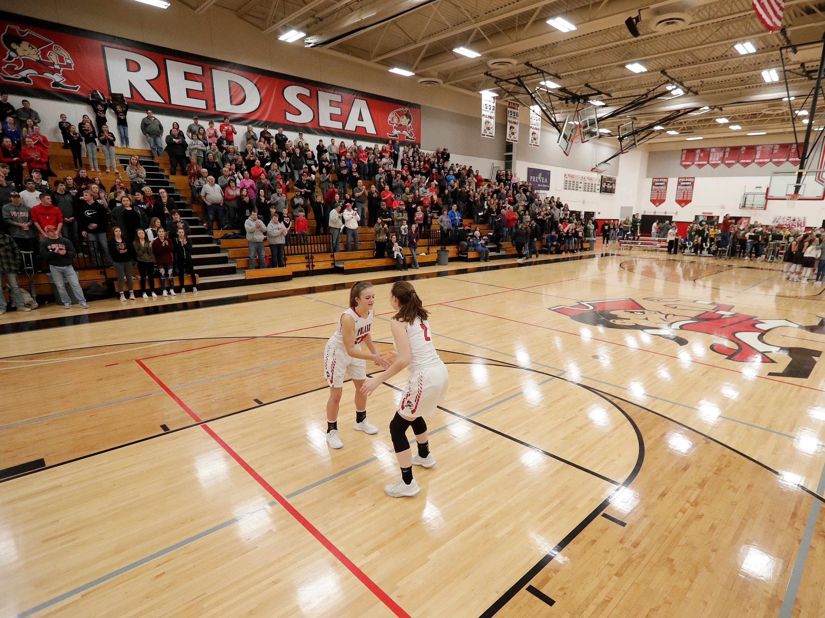 Pulaski's Isabel Majewski (2) is introduced for a girls basketball game at Pulaski high school on Friday, January 4, 2019 in Pulaski, Wis.