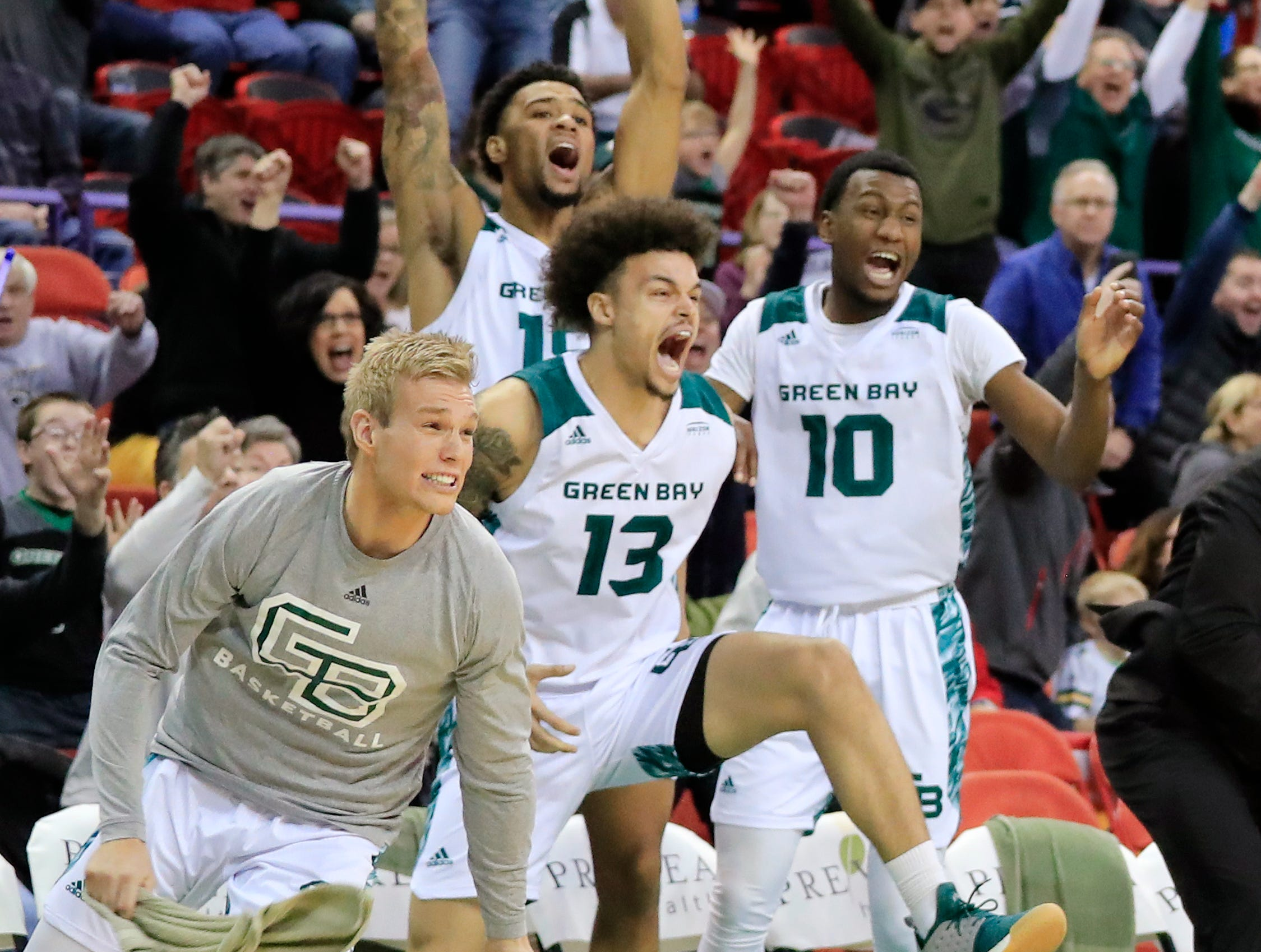 Green Bay Phoenix guard Trevian Bell (13) celebrates as the Phoenix win at the buzzer against the Cleveland State Vikings in a Horizon League basketball game at the Resch Center on Saturday, January 5, 2019 in Green Bay, Wis.