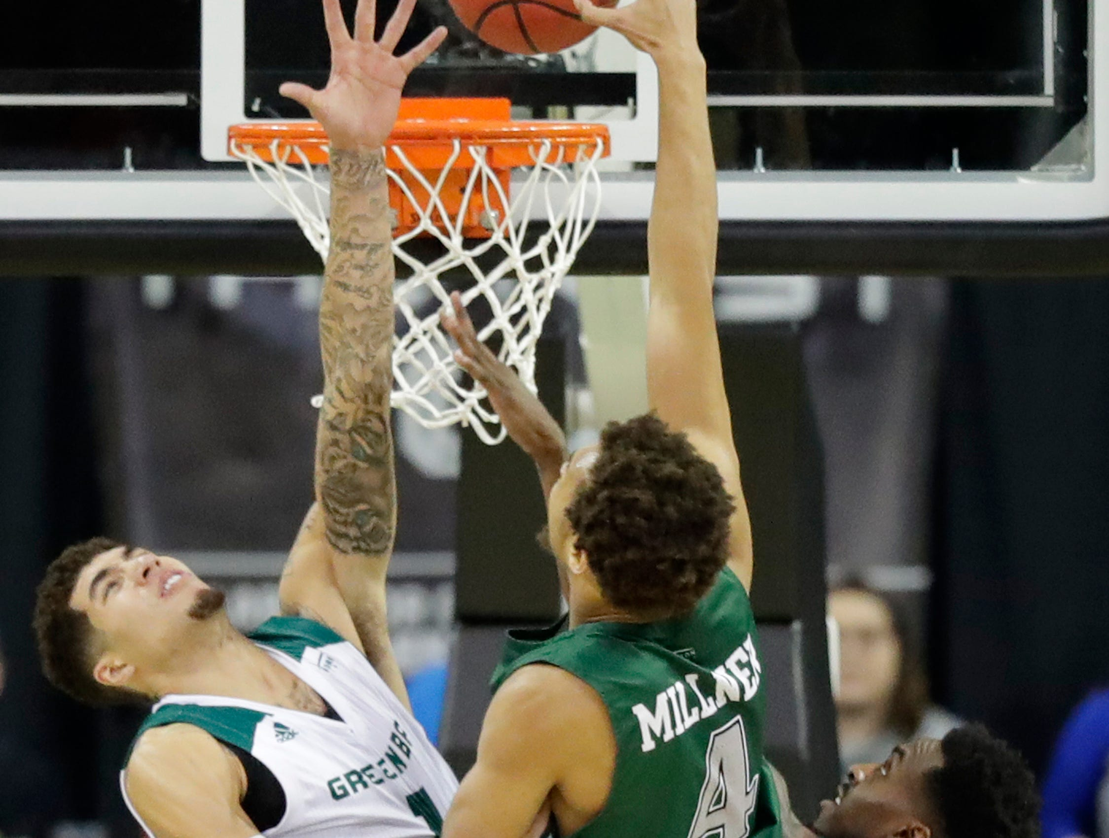 Green Bay Phoenix guard Sandy Cohen III (1) blocks a shot by Cleveland State Vikings forward Seth Millner (4) in a Horizon League basketball game at the Resch Center on Saturday, January 5, 2019 in Green Bay, Wis.