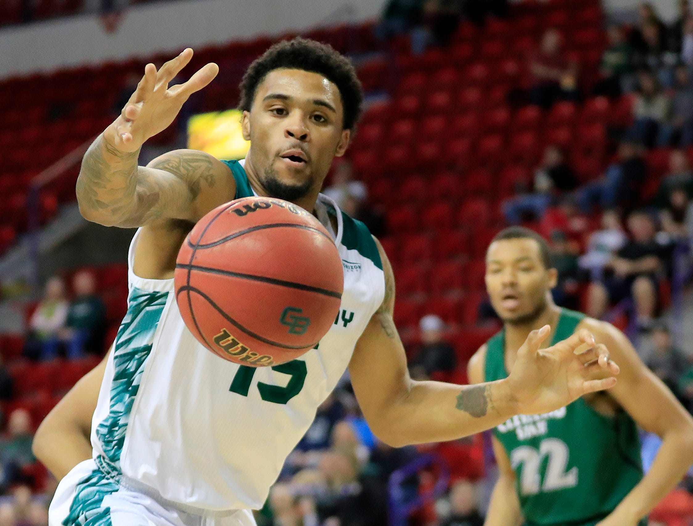 Green Bay Phoenix forward Manny Patterson (15) grabs a rebound against the Cleveland State Vikings in a Horizon League basketball game at the Resch Center on Saturday, January 5, 2019 in Green Bay, Wis.