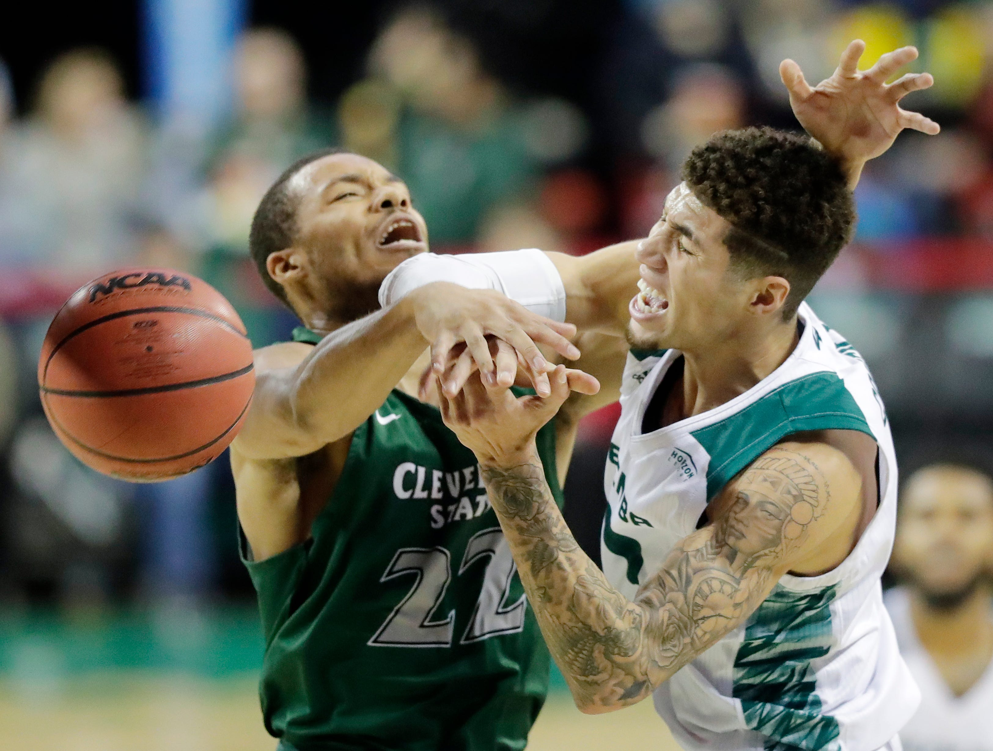 Green Bay Phoenix guard Sandy Cohen III (1) gets fouled by Cleveland State Vikings forward Jaalam Hill (22) in a Horizon League basketball game at the Resch Center on Saturday, January 5, 2019 in Green Bay, Wis.