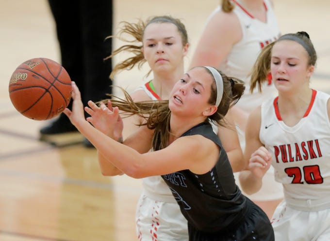 Bay Port's Emma Nagel (23) passes out of pressure against Pulaski in a girls basketball game at Pulaski high school on Friday, January 4, 2019 in Pulaski, Wis.
