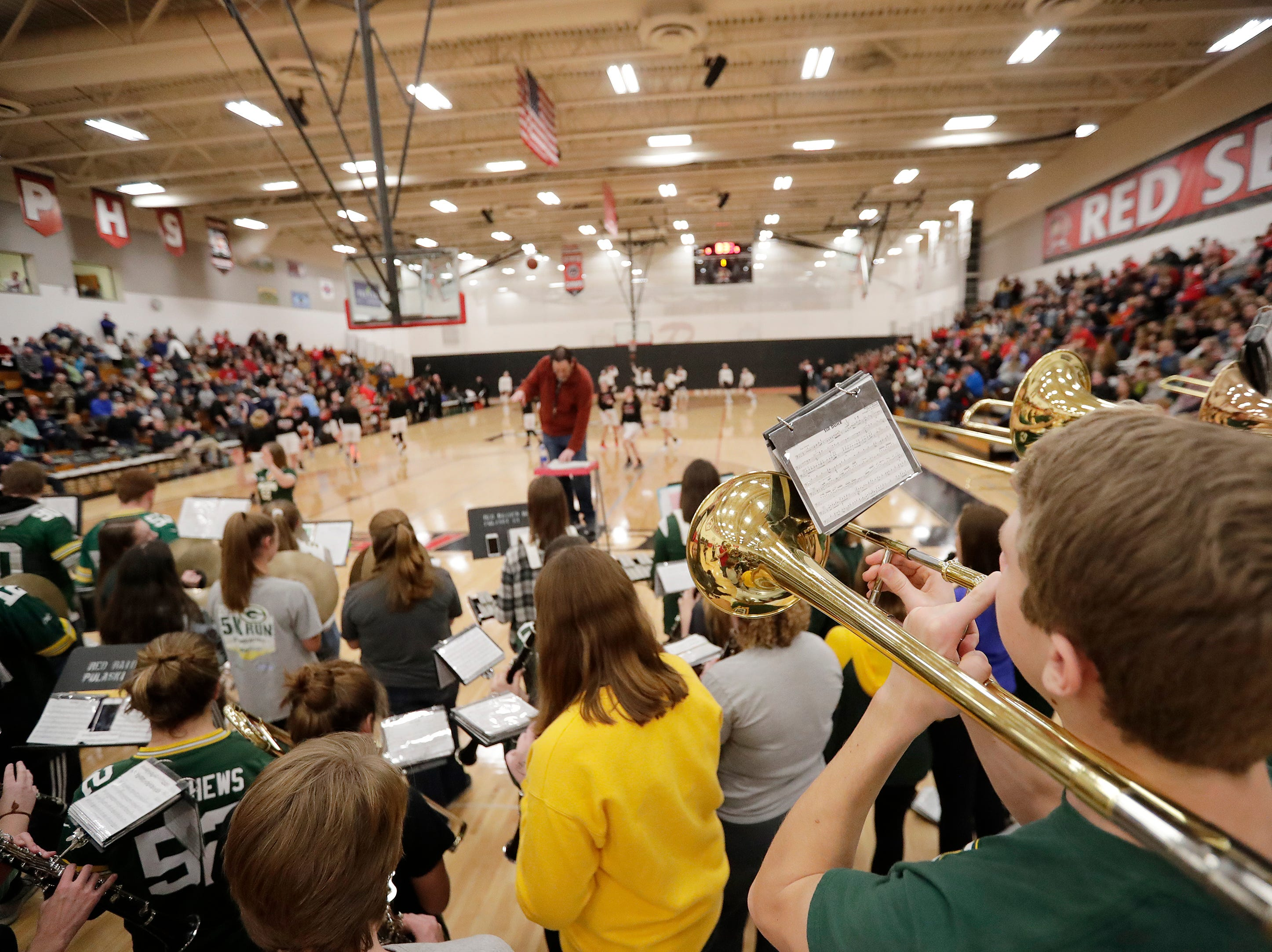 Pulaski's band performs before a girls basketball game at Pulaski high school on Friday, January 4, 2019 in Pulaski, Wis.