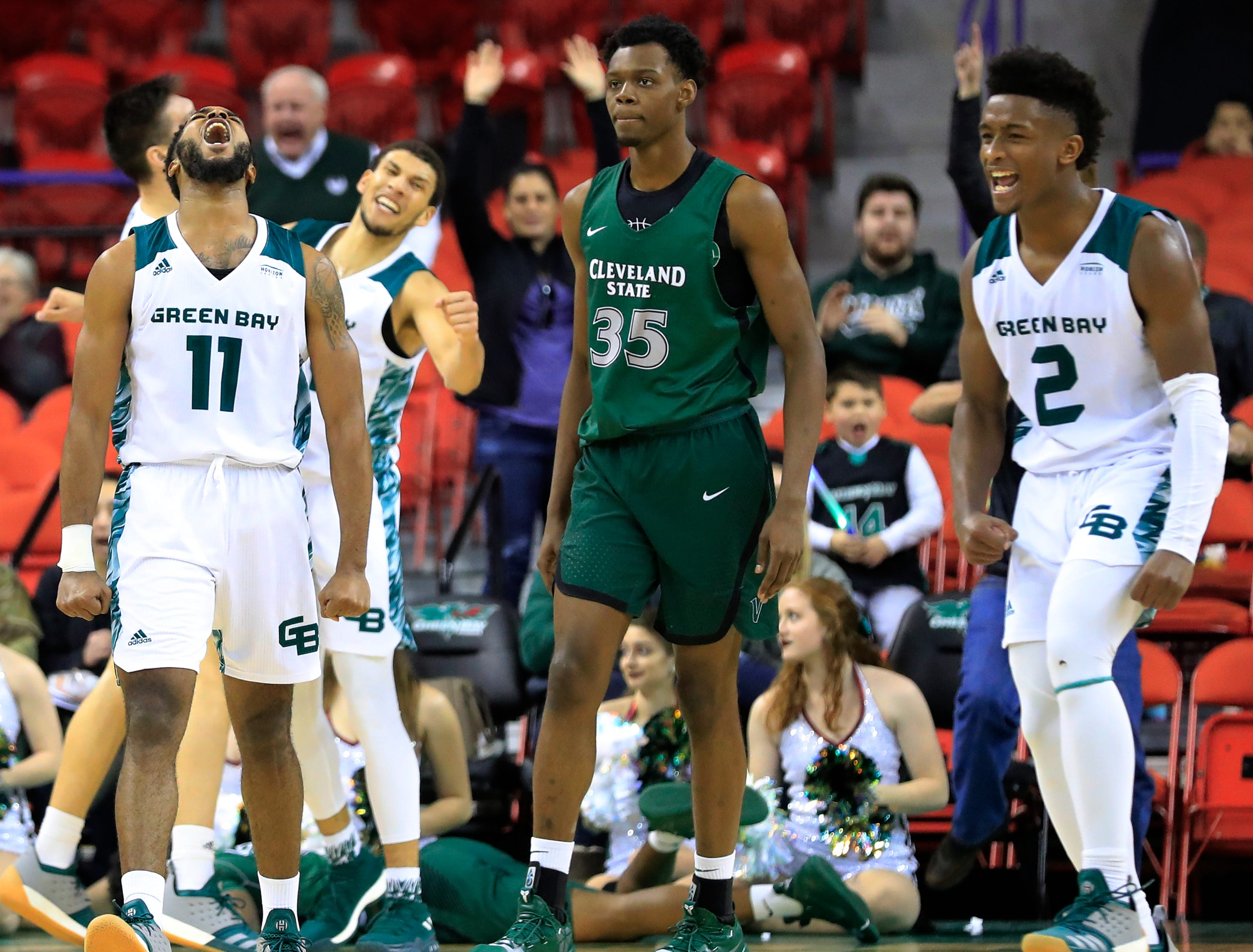 Green Bay Phoenix guard JayQuan McCloud (11) and guard PJ Pipes (2) celebrate after a defensive stop in the final minute against the Cleveland State Vikings in a Horizon League basketball game at the Resch Center on Saturday, January 5, 2019 in Green Bay, Wis.