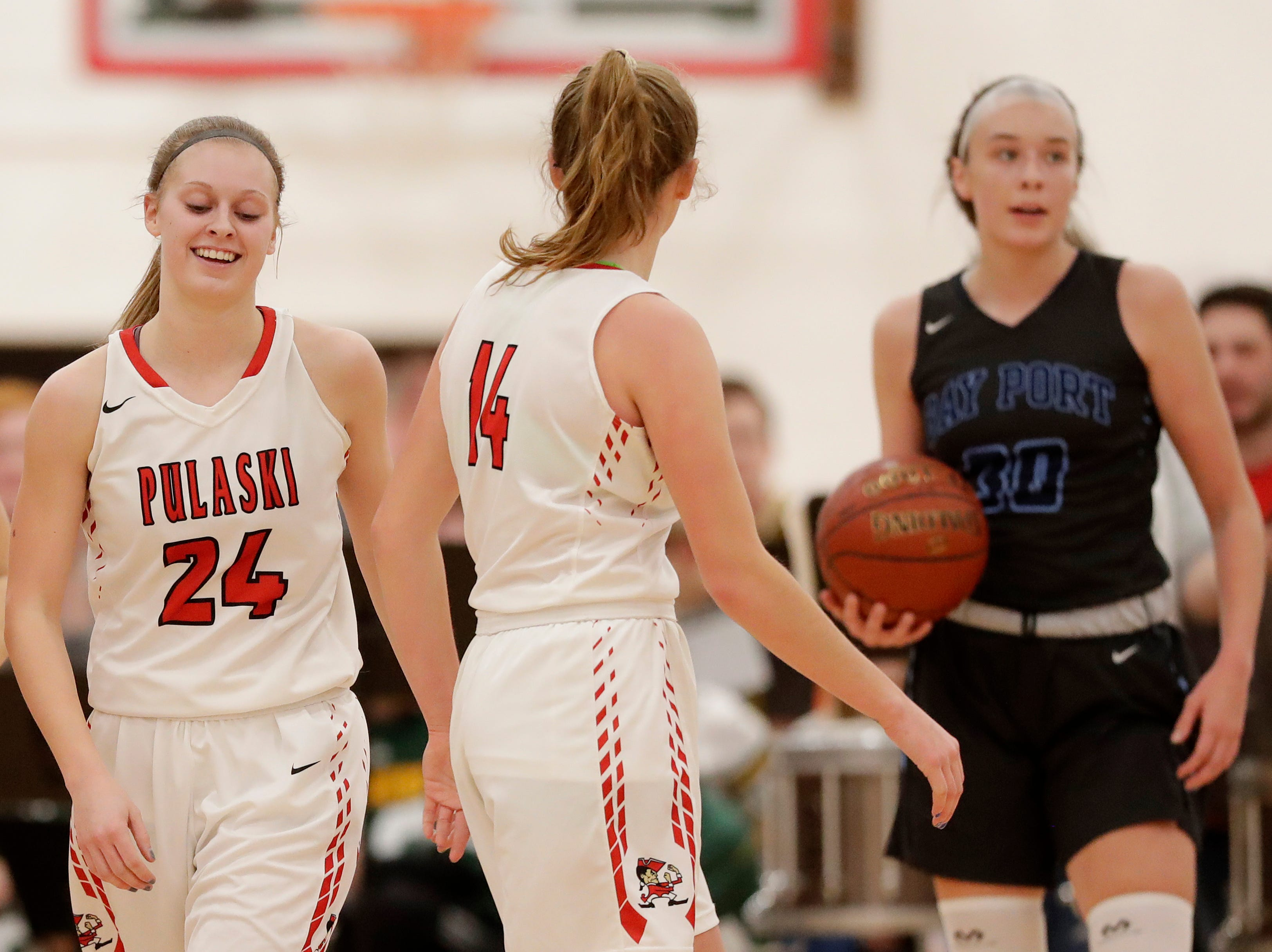 Pulaski's Chelsey Gilson (24) reacts after drawing a foul against Bay Port in a girls basketball game at Pulaski high school on Friday, January 4, 2019 in Pulaski, Wis.