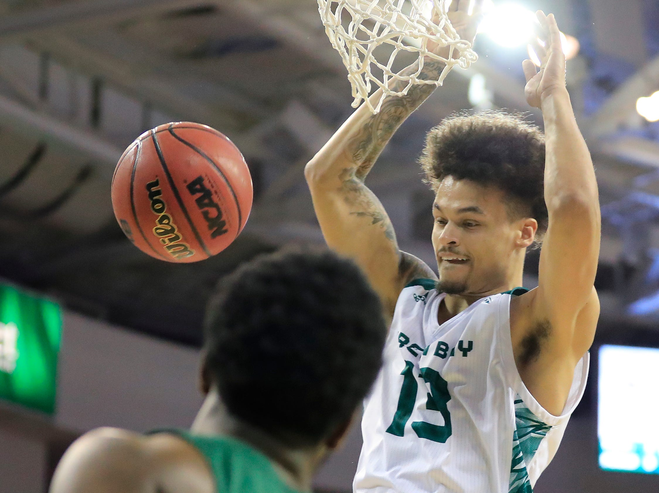 Green Bay Phoenix guard Trevian Bell (13) dunks against the Cleveland State Vikings in a Horizon League basketball game at the Resch Center on Saturday, January 5, 2019 in Green Bay, Wis.