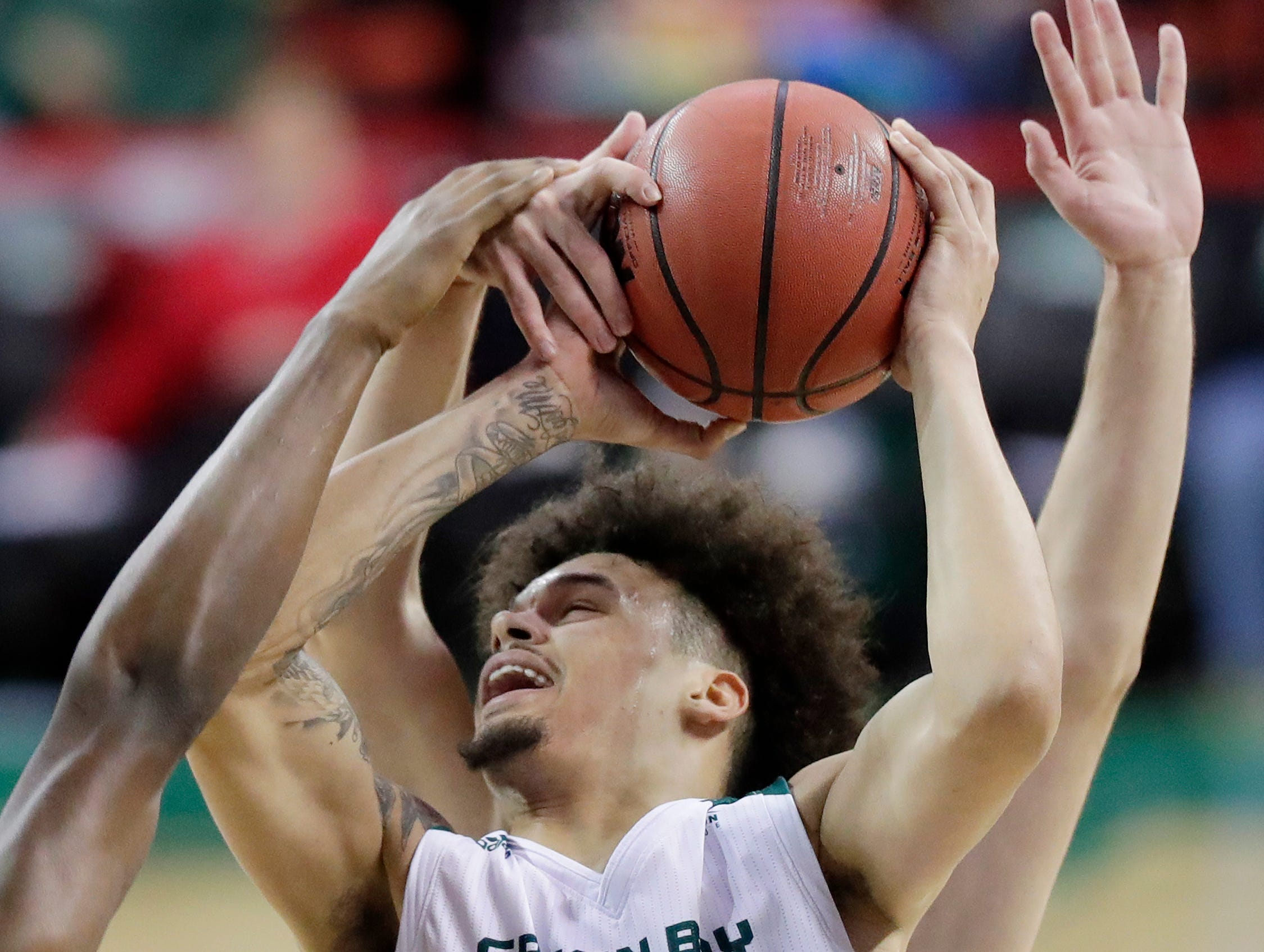 Green Bay Phoenix guard Trevian Bell (13) drwas a foul against the Cleveland State Vikings in a Horizon League basketball game at the Resch Center on Saturday, January 5, 2019 in Green Bay, Wis.